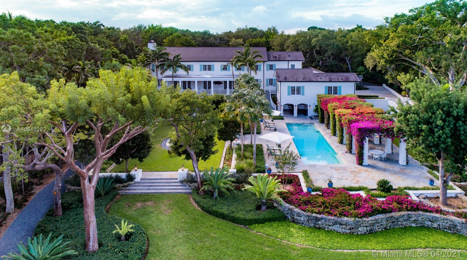 An impressive 205 ft of waterfront takes center stage at this exceptionally detailed, seven-bedroom, eight-and-a-half bath estate. Situated on over four acres in the beautiful waterfront community of Gables Estates, the home meets the highest expectations of luxury living and displays exquisite finishes. Elegant interiors are introduced via the great foyer with gorgeous staircase, which leads to spacious living areas, a gourmet kitchen, breakfast area, and formal dining room. The upstairs primary suite features a beautifully designed bath with marble floors. Perfect for outdoor living and entertaining, the property includes a summer kitchen, large wine cellar, gym, game room, and home theater. It has an incredible pool, spa, tennis court, and a dock providing direct access to Biscayne Bay.