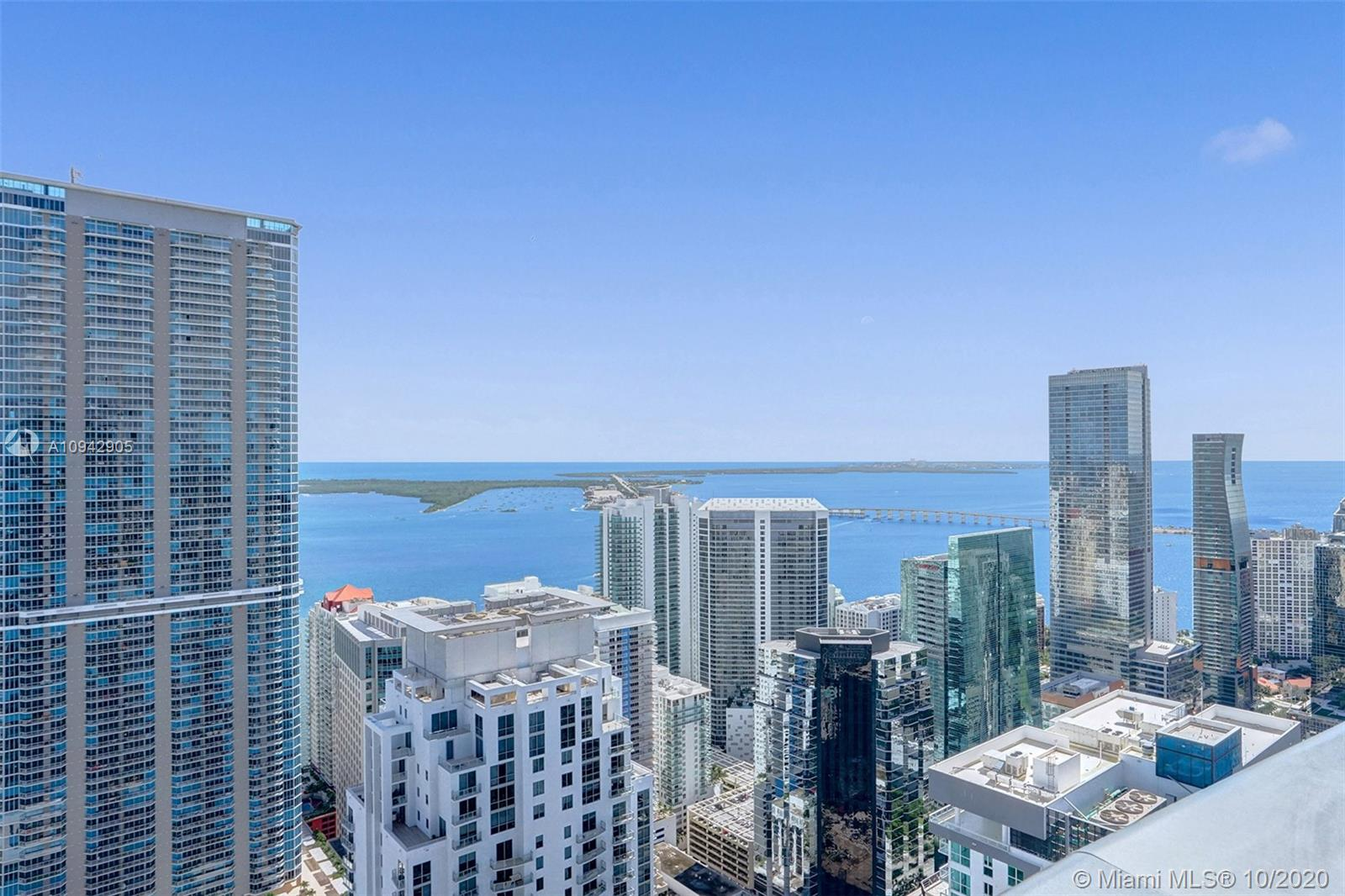 Panoramic east views capture Atlantic Ocean, Biscayne Bay, Magic City Skyline and the Port of Miami from this magnificent Penthouse perched atop the 60th floor. This spectacular Penthouse is the epitome of luxury, chic urban living.  Some features include upgraded built-in furniture in living room and master bedroom. Beautiful light fixtures installed throughout. Wall fabric installed by Orlean. Travertine floors, Snaidero kitchens, and 10ft ceilings. No detail spared in this 64-story wonder built by Ugo Colombo's CMC Group. State of the art fitness center and spa. Other great amenities include recreation rooms, children's play area, game room, and movie theater. Brickell area cafes, bars and restaurants are just an elevator ride away. Just steps from Brickell City Center.