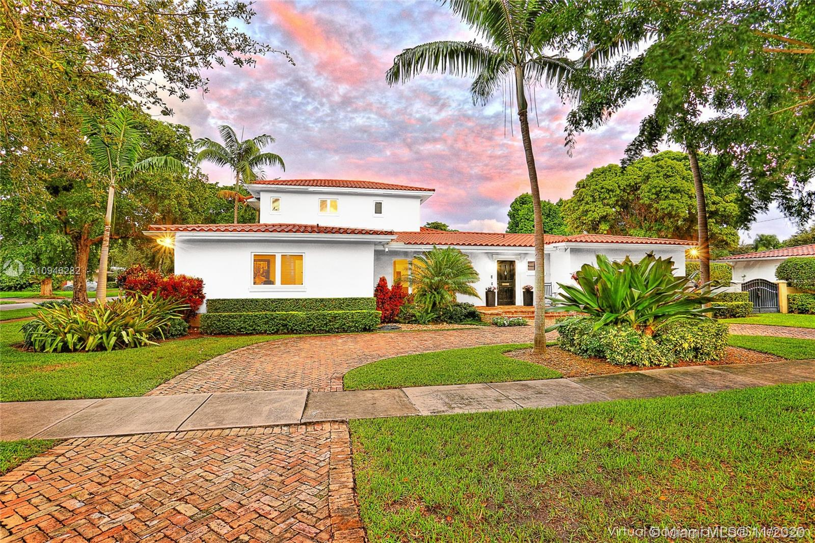 Wonderful 5 BR, 4 BA home on a prestigious & quiet South Gables street.  Beautifully renovated, this spacious home offers high ceilings, hardwood floors, foyer entry, gracious & open liv spaces, impact windows & doors, great split floorplan & stunning pool & patio area.  Formal liv & din rooms create an elegant feeling & offer the perfect entertaining spaces.  Open family room & kitchen, a rarity in the Gables market, offer breakfast nook, 17' x 21' fam rm w/ French doors to pool & patio.  Private upstairs principle BR w/ sitting room, 2 generous closets, spacious BA w/ sep tub & shower & dual vanities.  3 BRs/2 BAs on one wing and separate BR/BA on the other side.  Private 12,500 sf corner lot w/ fabulous outdoor entertaining spaces.  Laundry room, 1 car gar w/ storage, circular drive.