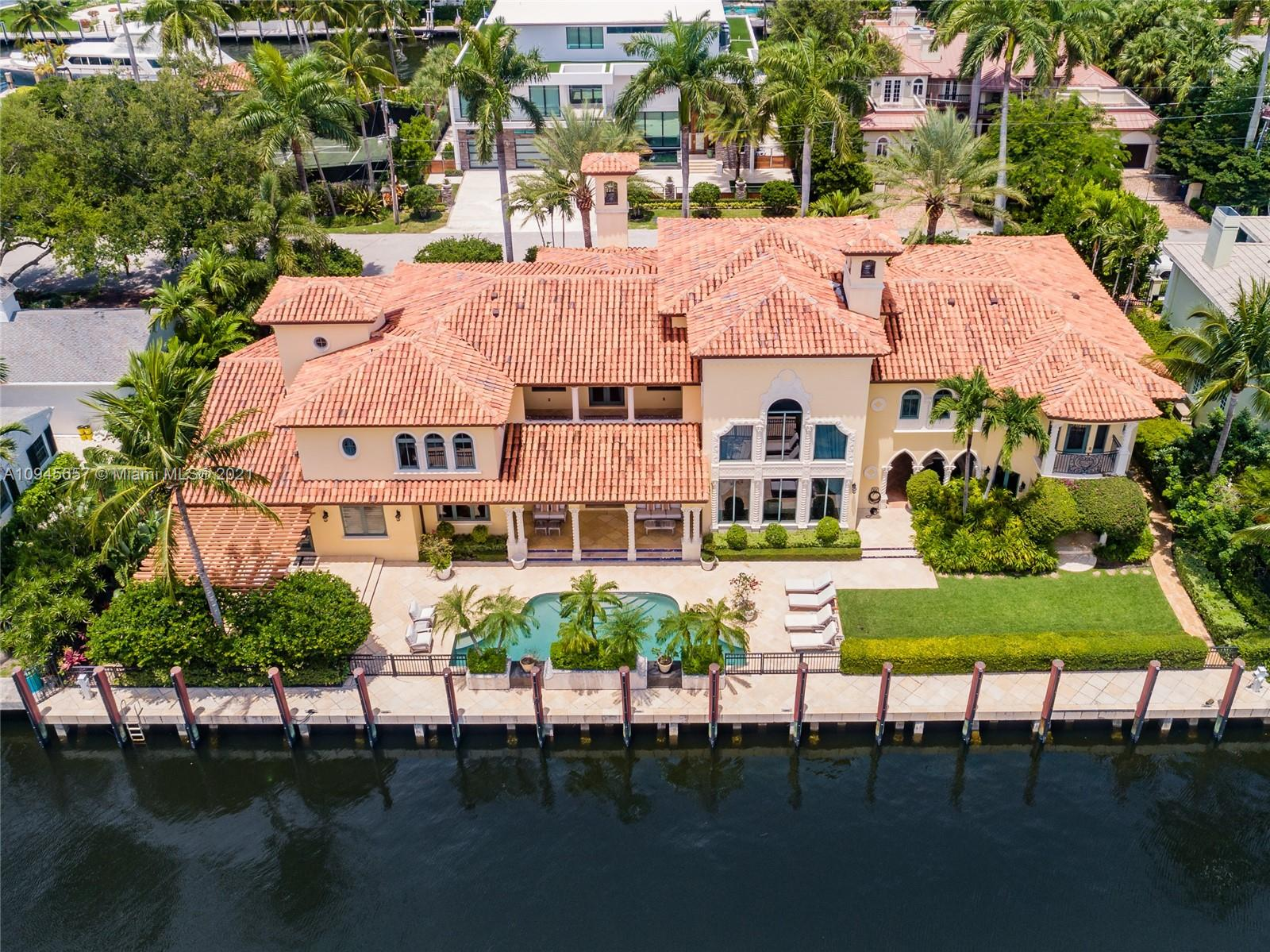 Stunning custom trophy estate located on one of the finest South Las Olas Isles & close to the point. This substantial & luxurious deep water residence has 150 ft of waterfront with dockage set-up to accommodate upto 130 ft yacht with easy access to the Port. Incredibly well built & detailed with amazing craftmanship - originally custom builder's own residence! Fabulous living & family room, Chef's kitchen, bar, wine cellar & Movie Theater room with more entertaining areas. Potential for substantial VIP Guest Suite & Staff/Captain Quarters on ground floor. The rooms are well proportioned throughout including Bedroom Suites & an amazing expansive Master Wing with two separate bathrooms. Many rooms open to covered loggias & balconies for outdoor enjoyment. Move in ready!