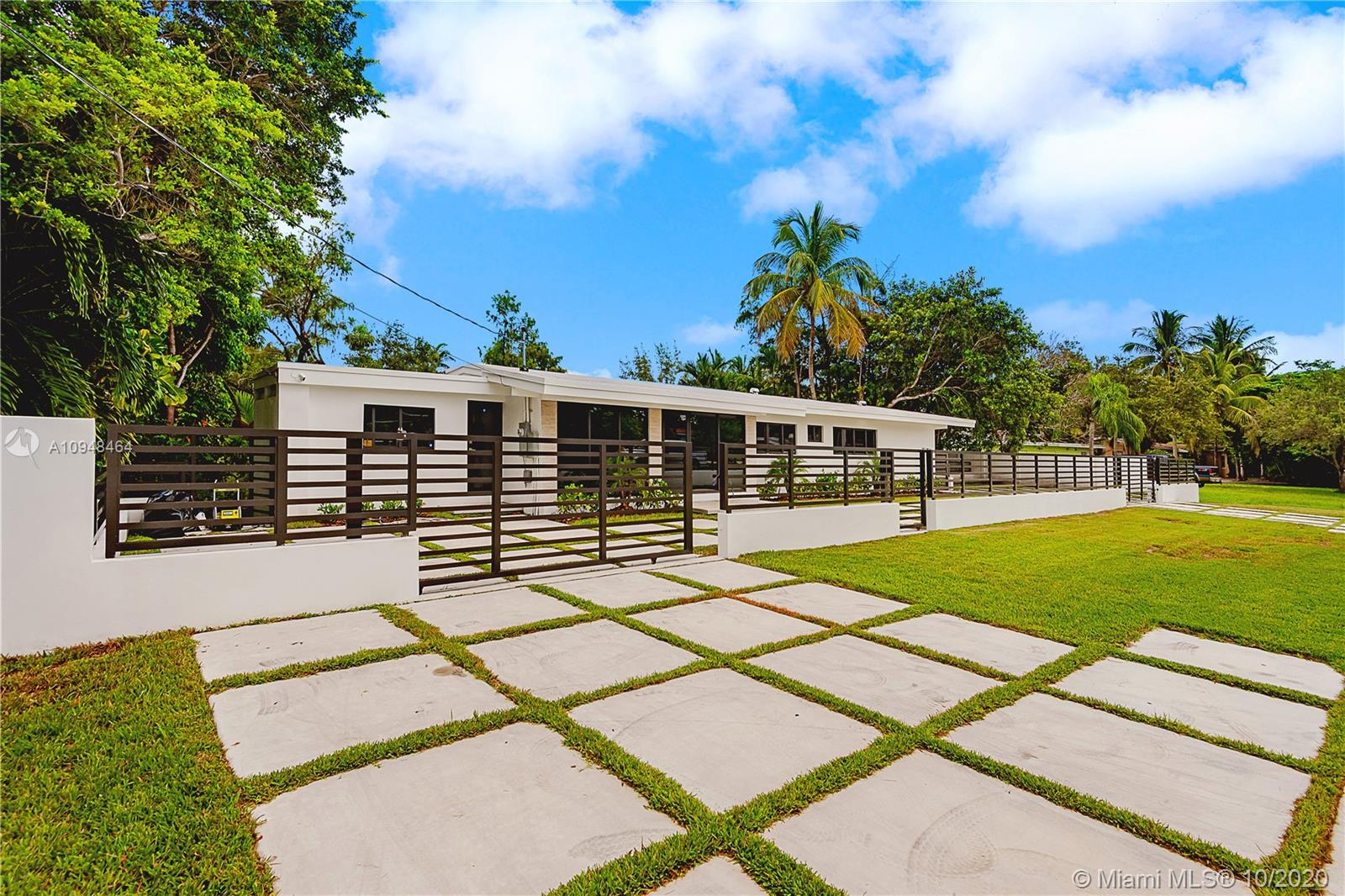 Completely remodeled to perfection.  This modern, sleek home offers everything new including plumbing, electrical, roof and impact windows and doors.  No costs spared, this 3 bedroom / 3.5 bath home boasts open spaces perfect for entertaining.  The elevated pool deck over looking the water and vegetation transports you to a place like no other in South Miami.  Ideally located and minutes away from the heart of South Miami, Downtown Dadeland and Coral Gables.