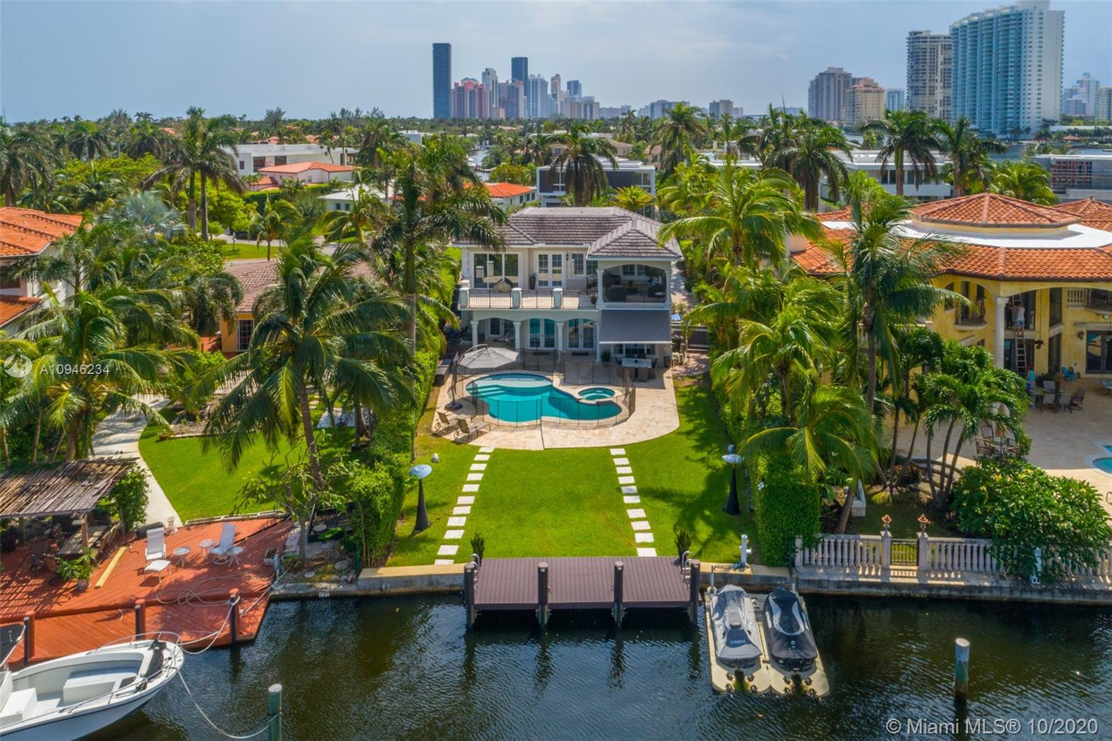 This turnkey Golden Beach chateau is primely located on the beautifully lush North Parkway, offering open water views and a deep backyard perfect for waterfront living. The home has been fully upgraded, boats 5 bedrooms, 5 bathrooms, 4,356 sq ft and the perfect balance of modern touches and warm finishes.