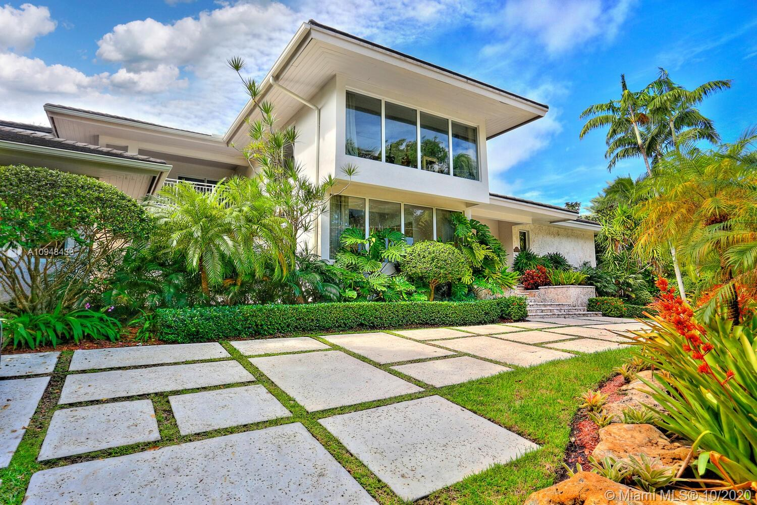 "Stunning waterfront home with a modern vibe in the guard-gated community of Sunrise Harbour.  Spectacular, light-filled open living spaces w/high ceilings, floating staircase and walls of glass overlooking the water & lush tropical gardens. Designer kitchen features lacquered cabinetry, island & top-of-the-line appliances + sunlit, glass enclosed breakfast room. Luxurious master suite opens to wrap-around balcony & features spa-like bath w/soaking tub & frameless glass rain-shower. Ideal layout includes formal living & dining + family room, sitting/reading area & 2nd level office. The home is elevated & offers expansive ""basement"" w/potential as gym, game room or storage. Resort- style outdoor spaces with a deep covered terrace, built-in grill & canal front dock with direct ocean access"
