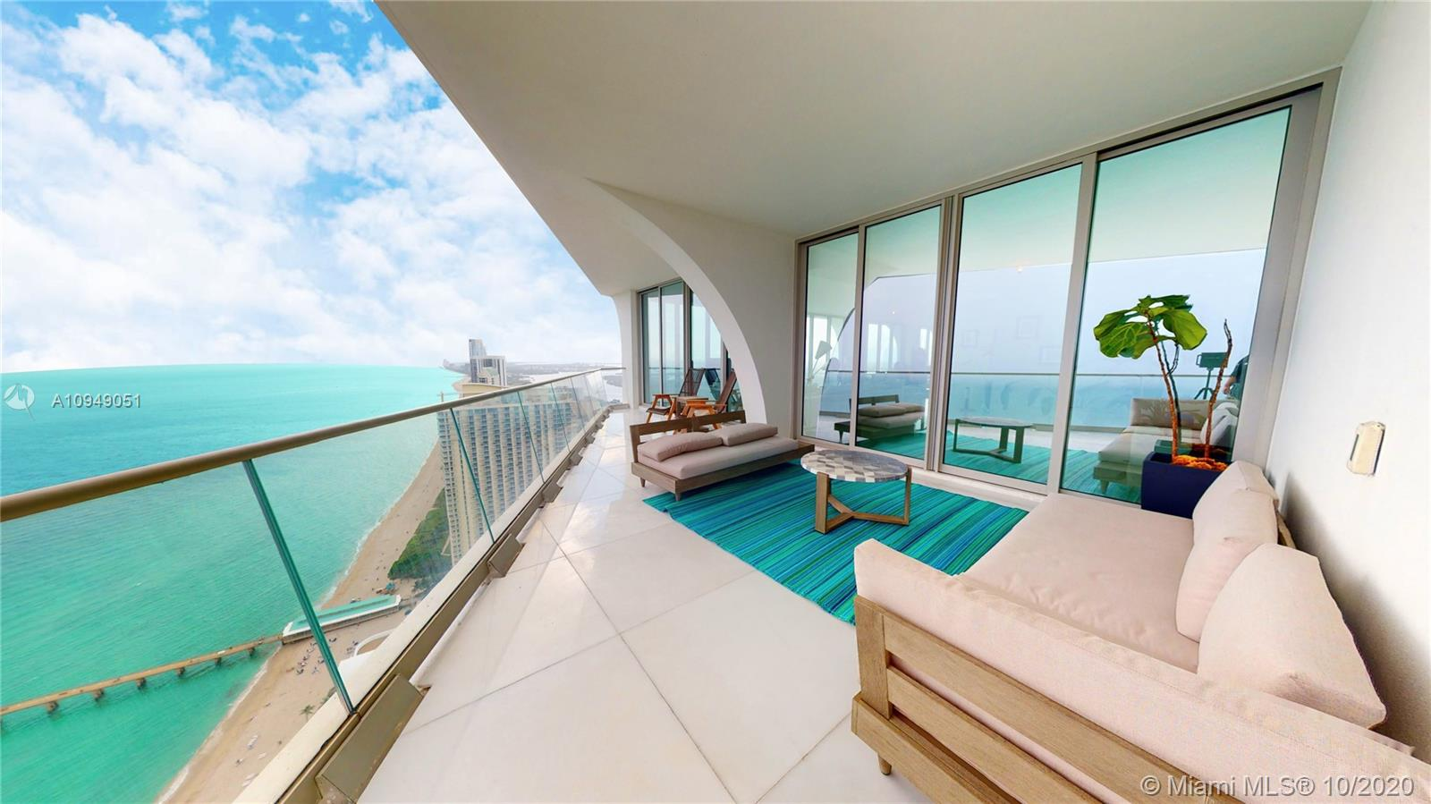 Spectacular corner residence in Award-Winning Miami Oceanfront Residences by Pritzker-Prize winning Herzog & de Meuron & the grand master of luxe, Pierre Yves Rochon.  This residence has 4 bedrooms 5 full bathrooms and 1 half bathroom with a family room and 5 terraces. Beautiful uninterrupted ocean and skyline views, floor-to-ceiling windows with immense natural sunlight shining through. Extraordinary resort-like experience with three floors dedicated to amenities that feature world-class on-sight dining, fully serviced spa, salon and outdoor water therapy terrace; fitness facilities with sunset yoga deck, Pilates/spin studios; teen tech lounge and toddler's sensory room. Virtual tour available