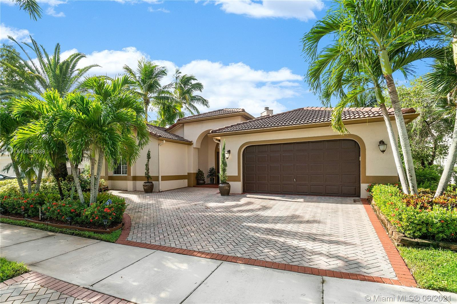 """Unique, totally remodeled and rarely available Courtyard Model in Prestigious Weston Hills. This waterfront/pool home features 3 BR/2 bath in the main home and a separate BR/office/in laws or den with full bath. Brand new 32"""" marble tiles throughout including master bedroom and 2 baths. New lighting throughout the house. New large MB closet with built-ins for shoes, drawers and shelves. Newly renovated lg luxury kitchen. New completely renovated master bath with new high end 6 ft long spacious cabinetry, quartz countertops,  crown molded mirrors, newly tiled surround whirlpool and all new faucets on both sinks and whirlpool. New floor to ceiling fireplace including new mantle and stonework. Crown molding and chair rail throughout LR, DR, kitchen and  hall.  Plantation shutters throughout."""