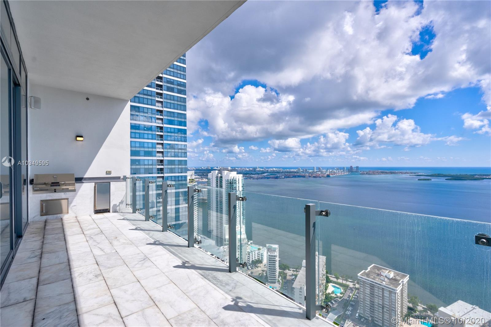 Incredible building from famous Carlos Ott!! Amazing Lower Penthouse unit never lived with endless and unobstructed views of Biscayne Bay and the ocean.  This Unit has 3 Bedrooms + den, 3 Bathrooms and a Half Bath; 12 ft high ceilings with floor to ceiling glass windows. Top of the line appliances (Wolf ), Sub-Zero Refrigerator,  wine cooler and built-in coffee & espresso machine.  Unit comes with marble floor and wood laminate in the rooms. Summer Kitchen with  Barbecue Grill in a Huge Terrace with unbelievable views. Building is considered  a five star Building with state of the art amenities including spa, fitness center, infinity edge pools, concierge service and a lot of other great features. You must see it!!