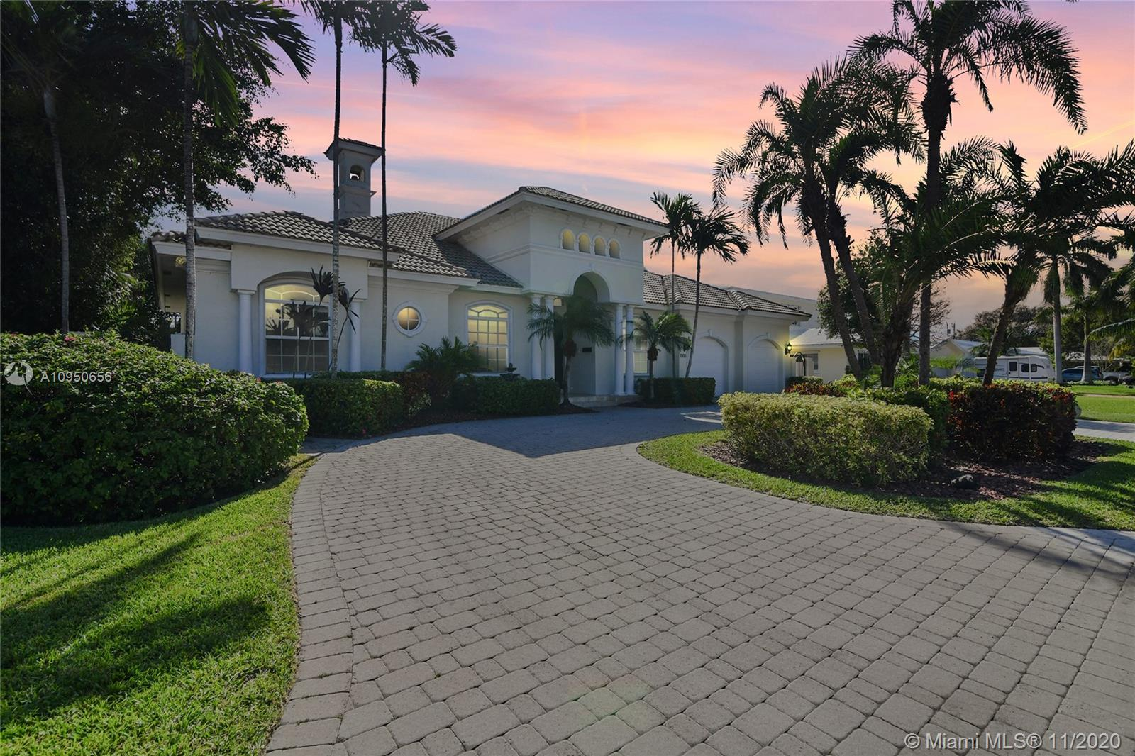 RARE OPPORTUNITY!!! BUILD IN 2003 ONE STORY 4 Bedrooms, 4 Bathroom home in Prestigious Venetian Isles in Lighthouse Point. Triple split floor plan, High/Vaulted ceilings, Stunning archways and finished to a very high level. Spacious living area overlooking thru tall impact glass french doors to a beautifully landscaped pool deck offers a formal living area with wood burning fireplace, formal dining room with wet bar, kitchen opens to family room. Master suite with his/hers closet. This elegant home boasts many custom features: Tall interior doors, 2 zones new AC, New appliances, Heated pool/spa, cabana bath, Outdoor shower, Two car garage, Surround sound, Hypo-allergenic AC filtration, Central vac system. Next to LHP Yacht Club. Wide private street with no traffic.