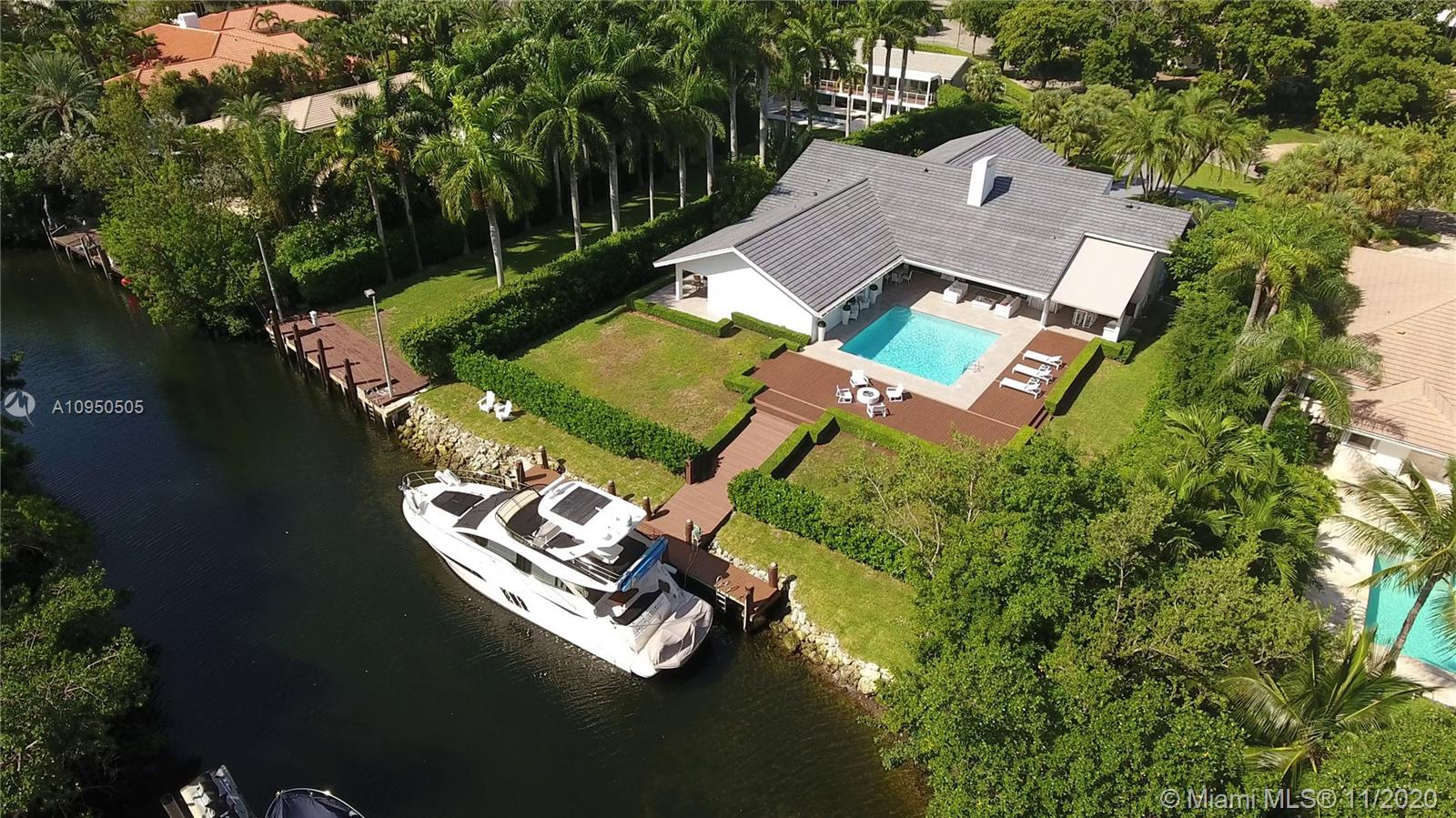 Beautiful waterfront home on a 27,908 sqft lot located in the coveted & gated Cocoplum. Gracious floor plan features living & dining rm that open to the outdoor terrace & pool area. Large eat-in kitchen, separate laundry rm & huge family rm w/balcony. The main suite overlooks the pool area & features a walk-in closet, spacious bath w/it's own private terrace. There are 2 additional bedrms each one w/a bathrm in this wing. The other wing includes an office, guest bedrm w/it's own bath & a full cabana bath leading to the pool area. Enjoy the outdoors w/a spacious covered terrace, outdoor kitchen & bar, pool & dock. This property has a 114 ft waterfront w/ocean access. 2-car garage w/custom cabinets. New roof & impact windows and doors installed in 2019. Cocoplum Sec 1 is special tax district