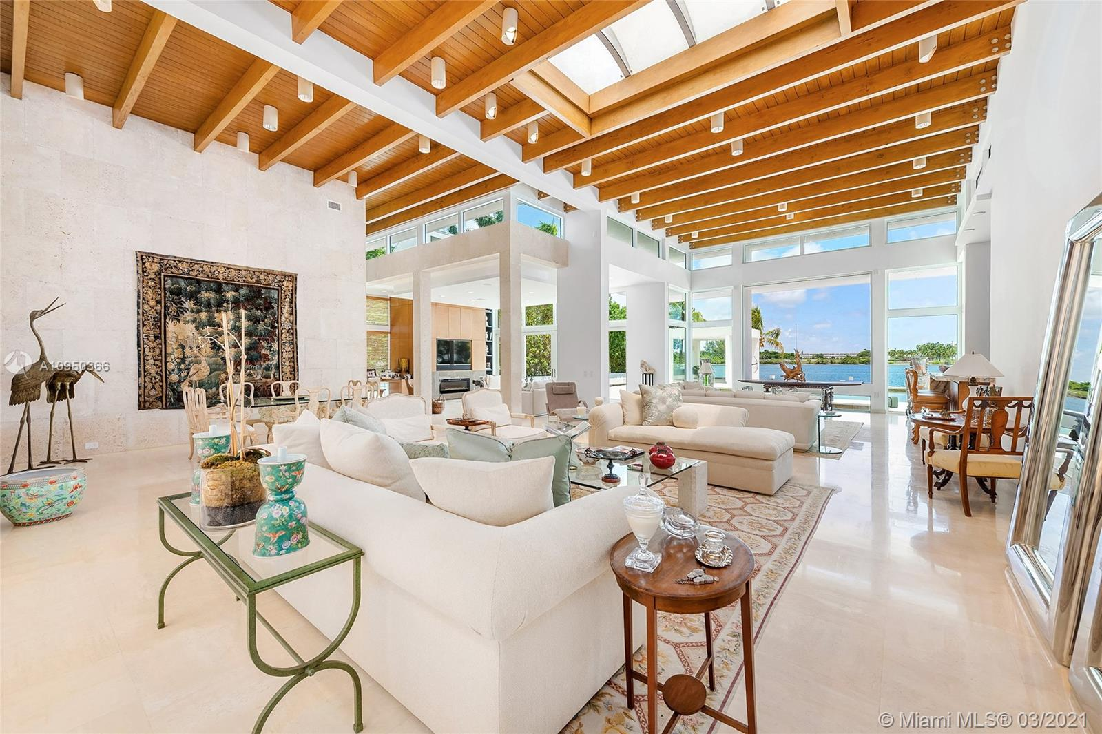This contemporary bi-Level waterfront home sits on a 25,804 SF lot in guarded Sunset Island I. The 6BR/6+2BA split floor plan home features marble floors, amazing architectural design, custom walls & built-ins, soaring wood-beamed ceilings, skylights & large windows to enjoy true indoor/outdoor living. Amazing extended living room w/custom bar, open dining & family room w/fireplace all w/views to the pool & bay. Gym, office & temp/controlled wine room. Gourmet eat-in kitchen w/top-of-the-line Thermador & Sub-Zero appliances, butler's pantry & separate breakfast area. The sumptuous principal suite features a seating area, voluminous dual walk-in closets & Carrara marble bathroom w/dual walk-in showers & spa tub. Large pool w/fountain, covered seating area, 97'WF, direct Bay & Ocean access.