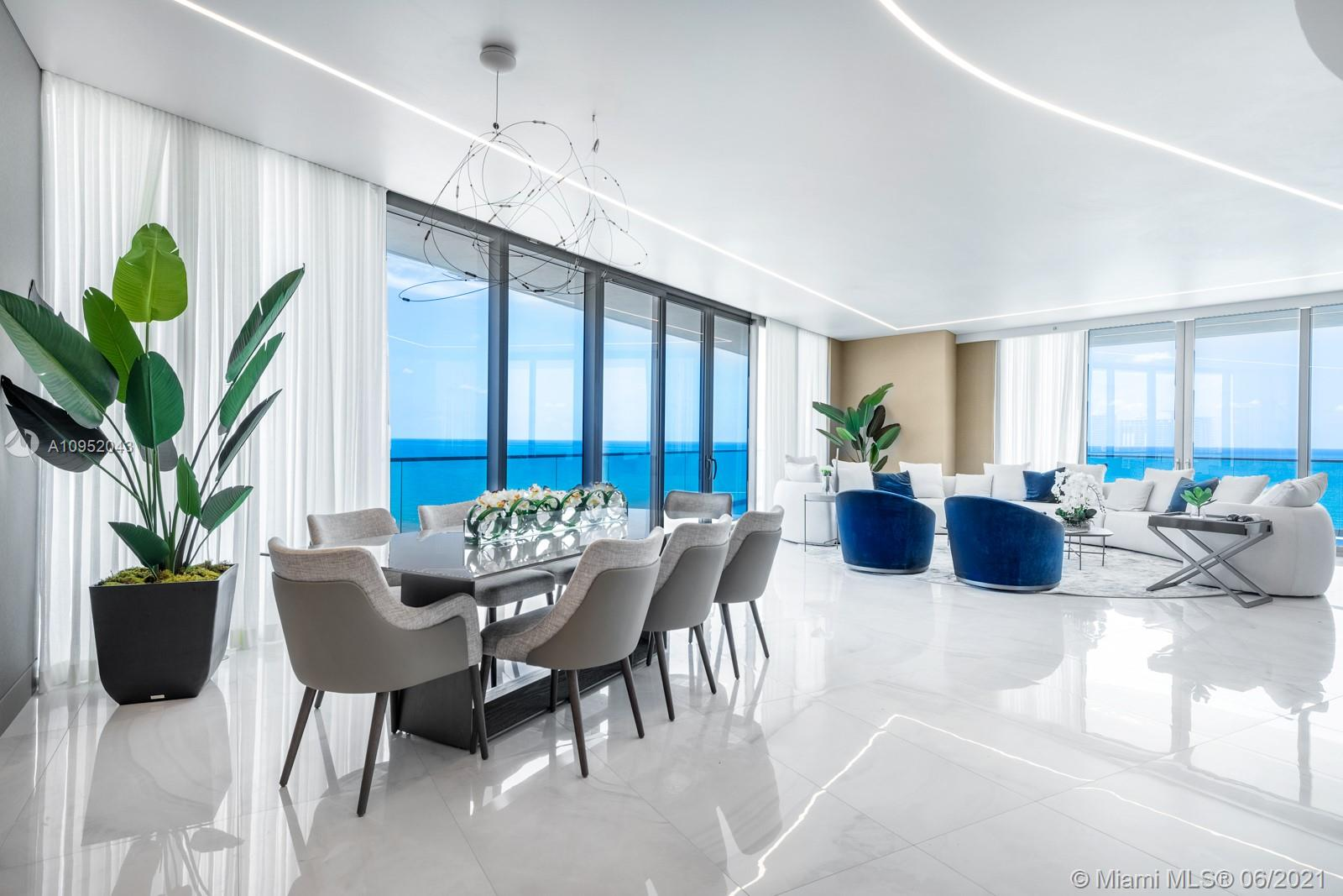 One of the most beautiful residences at the one and only Residences by Armani Casa in Sunny Isles Beach. This corner apartment is a brand new 4 bedroom, with 5.5 baths and laundry, featuring 3,748 sq. ft. plus 1400 sq. ft. in terraces, totaling 5,148 sq. ft. Showcases ocean and city views with two large terraces, floor to ceiling windows, split floor plan, volume ceilings, and summer kitchen on the balcony. Sophisticated elegance in the most sought after building in Sunny Isles.  Curated and designed by Adriana Hoyos, this flawless finish transmits a unique, modern and sophisticated look and feel for very special clientele. Full service building with room service, party room, game room, 2 level spa, restaurant, theatre, cigar & wine room, kids play room & beach cabanas.
