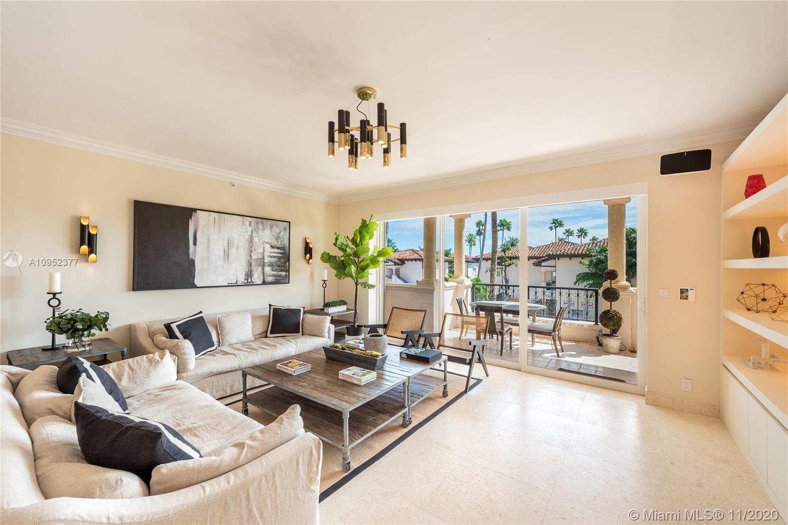 This beautiful contemporary 3BR/3BA Seaside Village unit has partial ocean & bay views and is perfectly located just a minute to the beach club, tennis, spa and more.  Offered fully turnkey, the unit can be rented for a minimum of one month (due to COVID).  Features coral stone floors, an open flowing living & dining room layout & direct access to a large terrace w/seating area & al fresco dining table to relax and entertain. The kitchen sports top-of the line appliances & serving counter to the dining area. The spacious principal suite offers direct terrace access, walk-in closet w/built-ins, crown molding & a beautiful principal bathroom with double sinks, glass/marble shower & private water closet. The other two bedrooms each w/en-suite bathrooms. Includes washer & dryer in the unit.