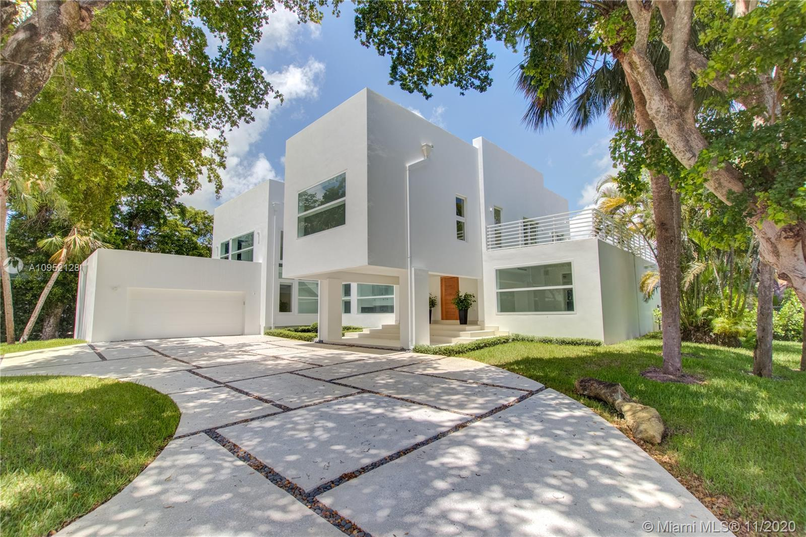 This custom built modern home stands out from the traditional and Mediterranean homes that are common in Cocoplum. As you enter the foyer you are welcomed by an open floor plan that allows you to take in the beauty of the family areas, and oversized pool patio area. 7-bedroom, 9-bathroom residence with office, den, guest quarters, and maid's room is perfect for entertaining. Superior finishes set this home apart. The oversized Snaidero kitchen with state of the art appliances, double dishwashers and a large wine fridge, is a chef's delight. The 3rd floor has guest quarters with a lovely bedroom, sitting area, large bathroom. Oversized windows to enjoy the beauty of Cocoplum. As per owner the square footage is larger than public records currently being reviewed by the county to correct.
