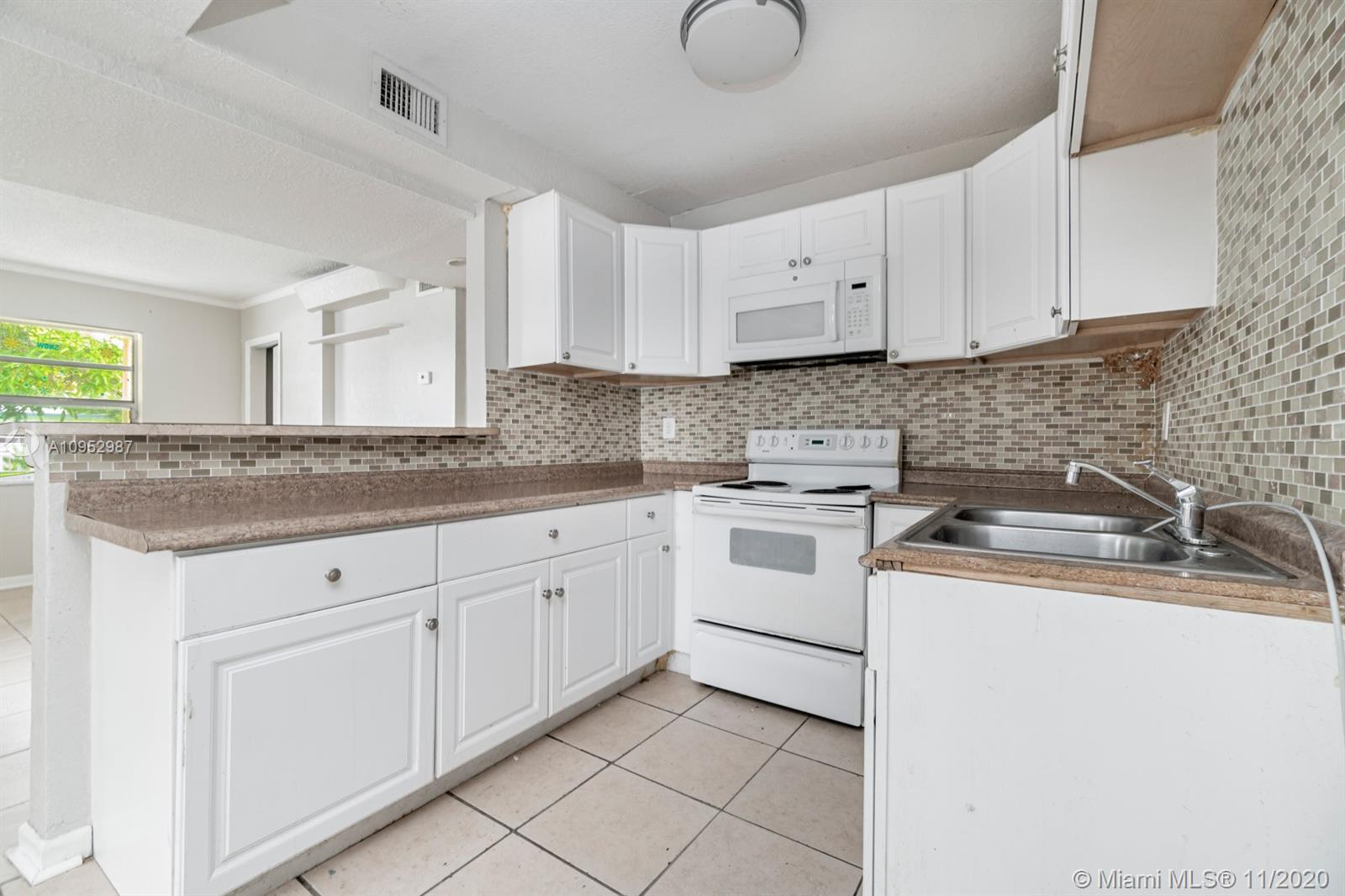 Remodeled 5/2 is ready for your personal touch! Property features ceramic tile floors, redone kitchen (tile backsplash, granite counters, new cabinets and appliances), updates in baths, laundry room, spacious lot with mature trees and so much more. Make this your home or investment today!