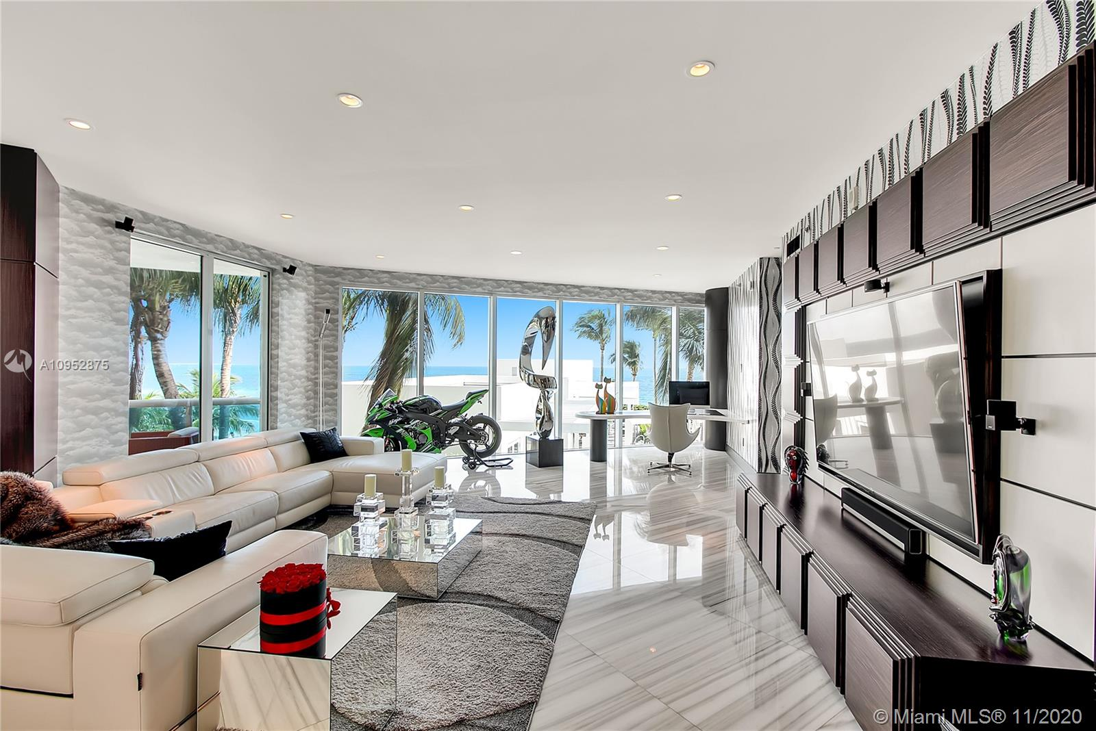 """Wow! The Crown Jewel of Luxurious Trump Hollywood! Beach Lanai w/ Private Deck Overlooking the Beach w/ Private Jacuzzi. Over a Million $ in New Renovated 3 Beds - 2 Story Showplace! Ocean Views Throughout! Contemporary Masterpiece! Finest Finishes: Smart system,48"""" White Marble Flrs, Custom Doors, Lutron + Murano Italian Glass Lighting, Theatre/ Nightclub w/ Lazers, Lights, Smoke Machine and Sound System & Custom Alligator Couch! Fabulous Art! Nothing Original Remains!  Walk Out to Pool! Special Rare Residence with All The Privacy of a House and Amenities of a Condo - Stunning! Exquisite Lobby, Unsurpassed Amenities incl. Breakfast Rm, Wine + Cigar Lounges, Fitness Center, Tennis, Spa, Massage Rms, Theater, Party Rm, Caterer's Kitchen, Pool + Beach Service, 24 hr Security, Valet, & more!"""