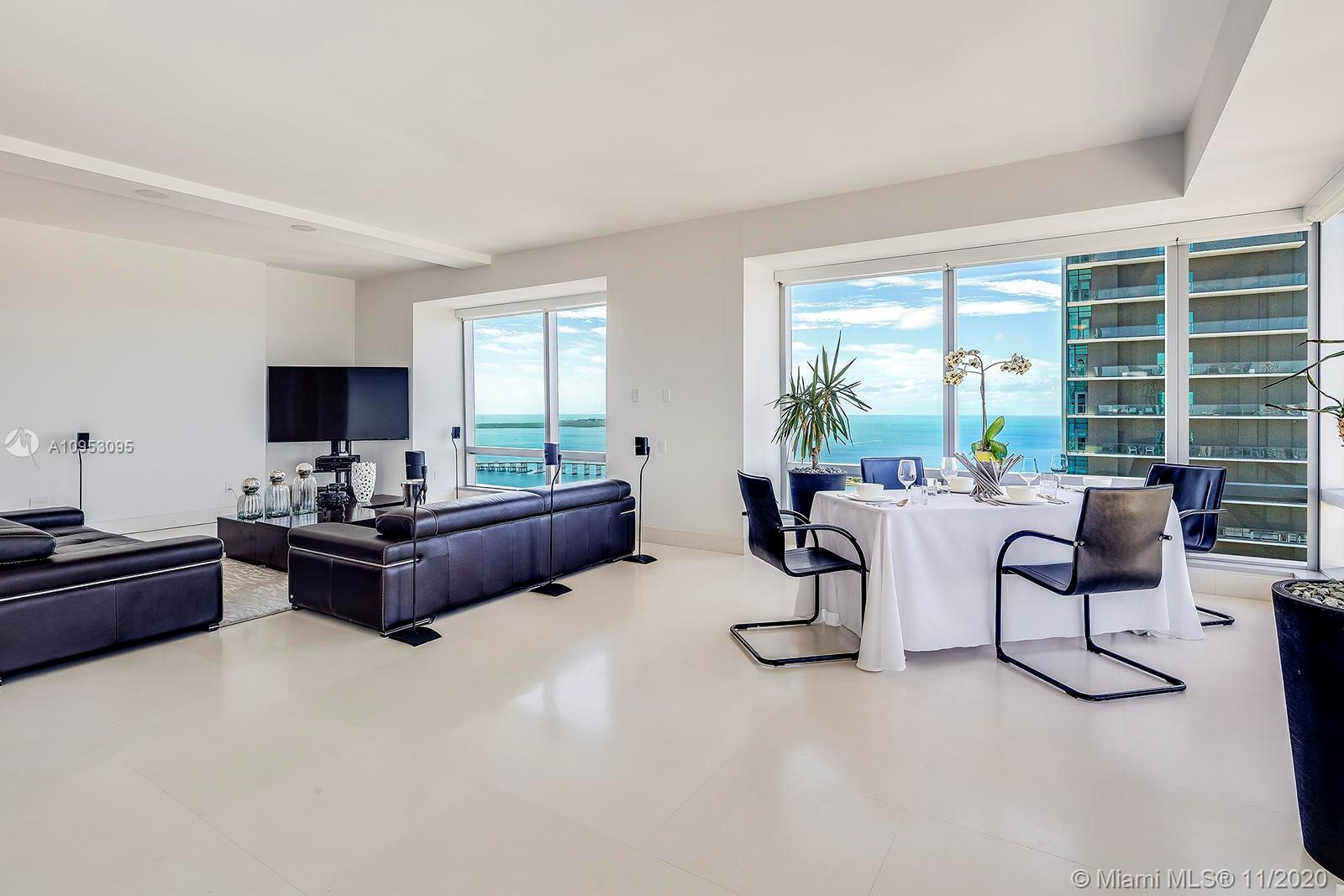 MASSIVE PRICE REDUCTION! Reduced from $1.795m by a motivated seller... Luxury with amazing lifestyle as only Four Seasons Residences can do... Don't miss this spacious 2 bedroom, 2.5 bathroom corner condominium that feels more like a home than a condo, with its breathtaking floor-to-ceiling wraparound water and city views soaring high above the magnificent Biscayne Bay and prestigious Brickell neighborhood. With full access to the beautiful Four Seasons Miami hotel facilities boasting 3 landscaped pools, Jacuzzi, complimentary 24-hour concierge & valet, cabanas, restaurants, bars, owners' lounge, access to the 50,000 sq-ft luxurious Equinox spa & gym, and so much more, this property is a must see!