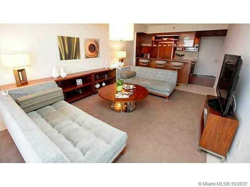 Park suite Z corner offers approx. 1,317 SF of Total Area! Spacious 1 bedroom with king-size bed and den with an upholstered sofa bed that may work as a 2nd bedroom/Office. Completely equipped with sheets, towels, china & kitchen utensils. Parking on the same floor! Full-width bayfront balcony. Wood-paneled accent walls & ceilings in the kitchen. Jacuzzi style tub. Bosh appliances, stone floors & stackable laundry are but a few of the luxuries included in this unit with custom made furniture designed by Rockwell Group - Turn Key, Move-in Ready!