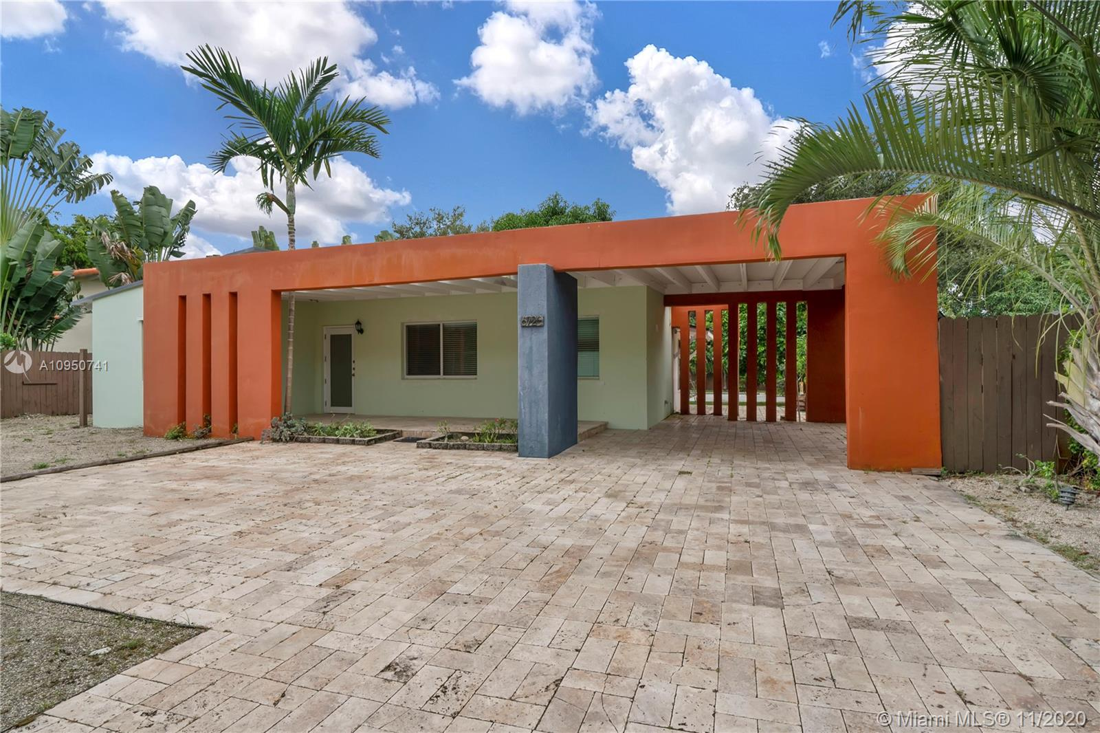 """The attention to the modern architectural details of this impeccable home in the heart of South Miami begins with the undeniably """"WOW"""" effect as soon as you enter the property. The home is bathed in soft light and offers a cozy, yet sophisticated atmosphere. The floor plan is also graced by a spacious family room where beyond the home's large windows and glass doors, the gorgeous backyard beckons for your attention. From its vaulted ceilings and updated kitchen and bathrooms to the spacious bedrooms and the inviting lap pool in the tropical garden, this home is primed for its newest owner. Built on over 10,000 square feet of land and surrounded by luscious grounds, wooden fences and a front iron gate, this property is perfect for privacy seekers with a desire for beauty."""