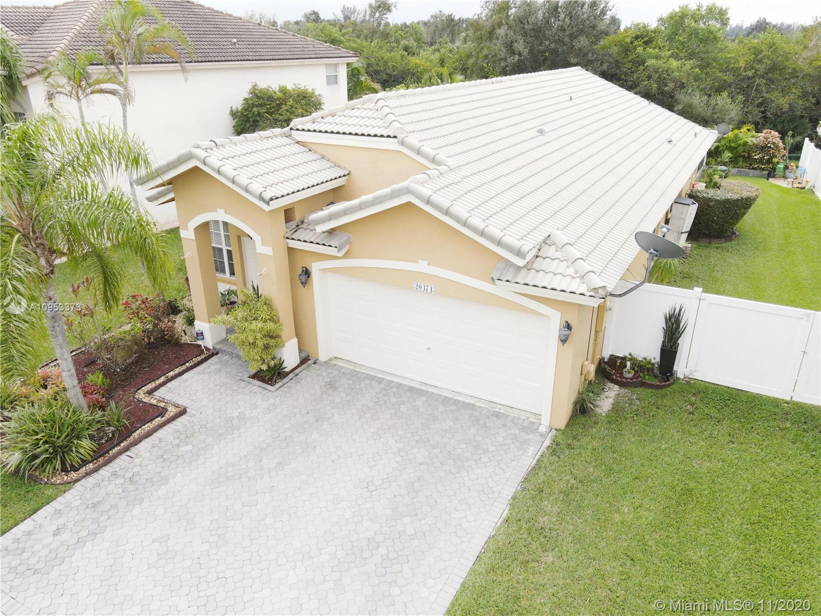 This Beautiful 3 Bedroom 2 bathroom House is located in a quiet neighborhood, on the west side of Pembroke Pines. Right off of Okeechobee road. Perfect first time family home, close to shopping centers, schools, supermarkets, and main roads. This home offers relaxed comfort inside and out. With an outside screened patio area great for entertaining .