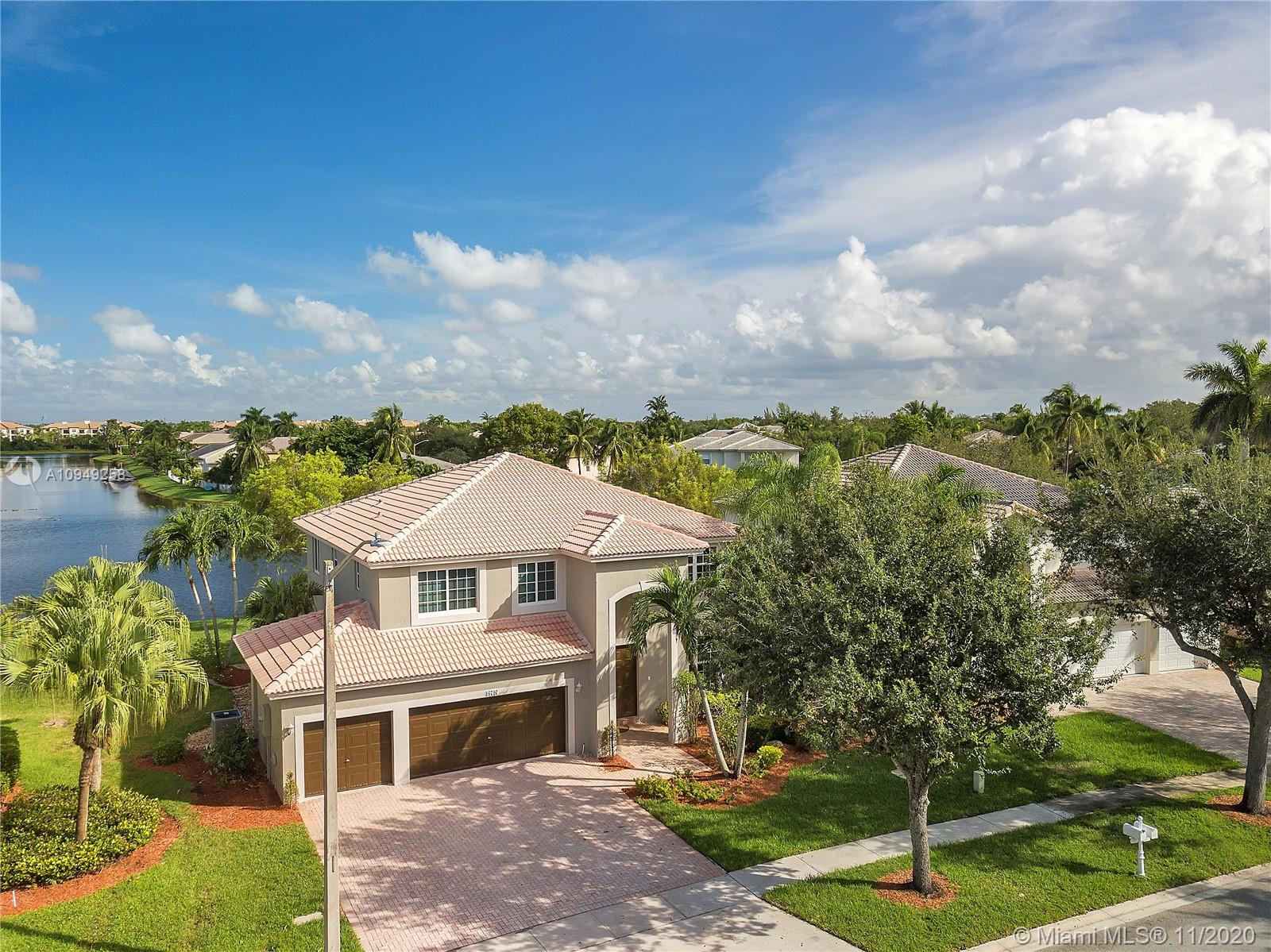 ***REMODELED LAKEFRONT SAN MARCOS MODEL HOME***SPECTACULAR WIDE & DEEP LAKE VIEWS***THE BREAKERS-PEMBROKE ISLES*** Featuring: Open Kitchen, Maple Wood Cabinetry, Granite Countertops, Stainless Steel Appliances, Serving Bar, Pantry, Spacious 2nd FL Master Suite w/Sitting/Guest Room, Tray Ceiling, ***RENOVATED BATHS*** Dual Walk-in Closets, Custom Wood Vanities, Jetted Jacuzzi Tub, Frameless Glass Shower Enclosure, Modern Lighting, New Porcelain Tile Flooring, Vinyl Plank Staircase, Freshly Painted Interior & Exterior, Expansive Balcony & Covered Patio ***NEW HURRICANE IMPACT WINDOWS & DOORS*** Tranquil WIDE & DEEP LAKE VIEWS*** Oversized Lot and Tropical Landscaping. The Perfect Family Home….  Pembroke Isles Amenities: Clubhouse, Pools, Tennis, Basketball, Fitness Center, Tot Lots & More!!!