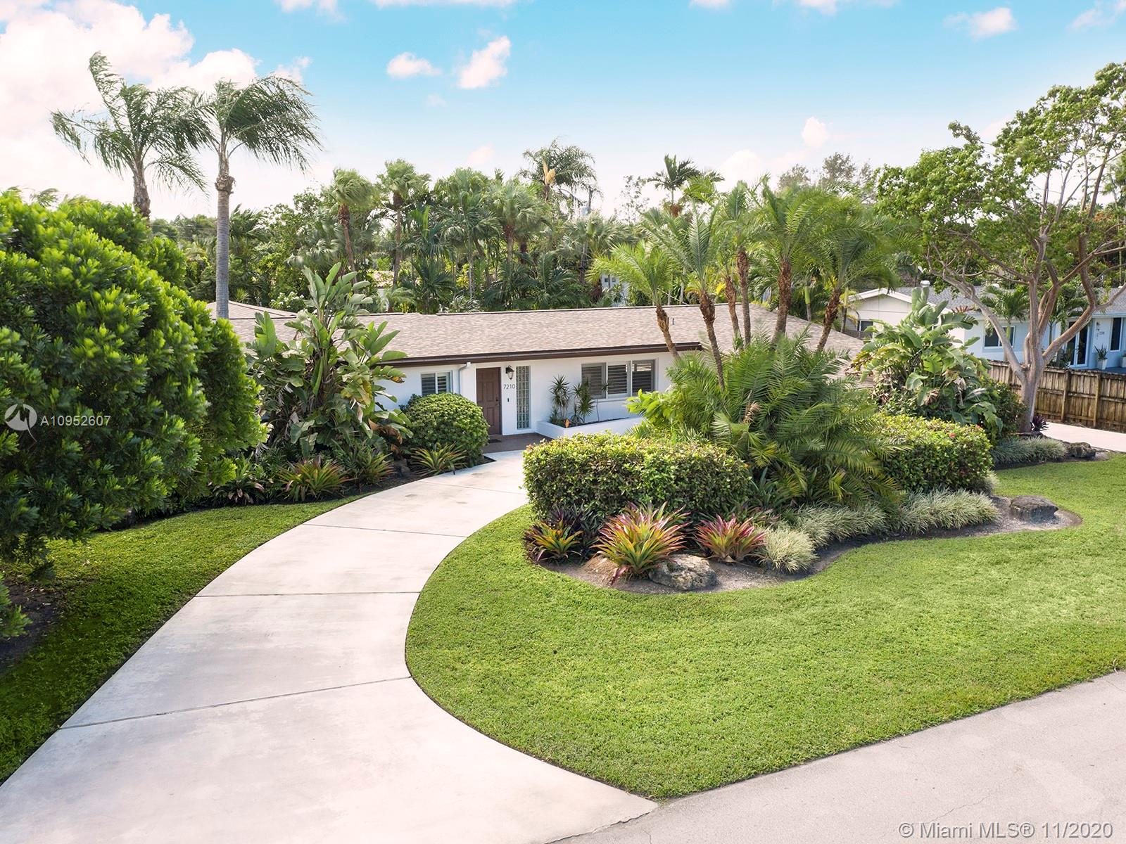 South Miami is looking for it's next homeowner and this eye catching mid-century home is just the right fit for your family. The home's 4 bedrooms and 3 baths are strategically placed to welcome the outdoors in from any vantage point in the home.  Lush, mature palms and vegetation along with coral rock surround a well thought out lagoon style pool and patio area. A new master bathroom, designer walk-in closet and roof have been upgraded for you. Impact windows will protect you during stormy times while allowing you a birds-eye view to Miami's ever present inclement weather.  The home boasts a domestic kitchen, plantation shutters and beautiful wood floors that lend to the South Florida lifestyle. Centrally located, this home delivers without compromising tasteful finishes or travel time.