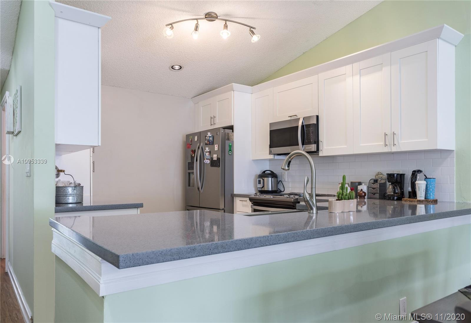 Upgraded Bright corner Villa with Garage. FHA approved. Roof maintained by HOA. NO RENTALS allows.  Fully renovated kitchen and bathrooms. Quartz countertop with modern wood cabinets. Lots of natural light. Comfortable size bedrooms. Community pool, close to shopping and Tamarac Sports Complex.