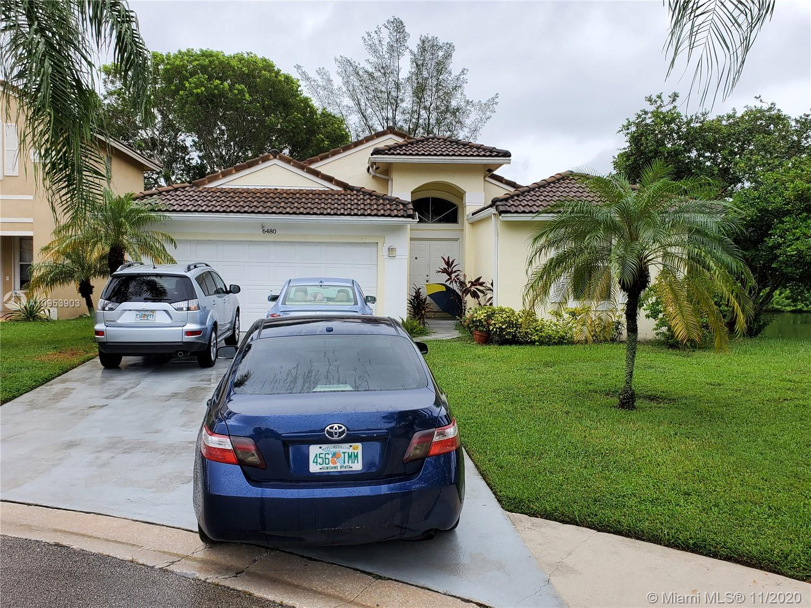 """Well kept 3/2 with split floor plan in cul de sac with expansive lake views in quiet gated community of Coco Bay, Coconut Creek. Master bath has separate shower & tub with dual sinks. Close to A rated schools. Please submit offers on """"AS IS"""" paper. No HOA approval required. See attachments for Seller's Disclosure. Room for pool. 6 ceiling fans. Supra in place but since owners will probably be home PLEASE ring door bell first and use the Supra only if no answer to the door. Thanks. A/C is 3 years old and water heater is 1 year new. Also new garage door motor and springs installed 11/11. Flood Zone X."""