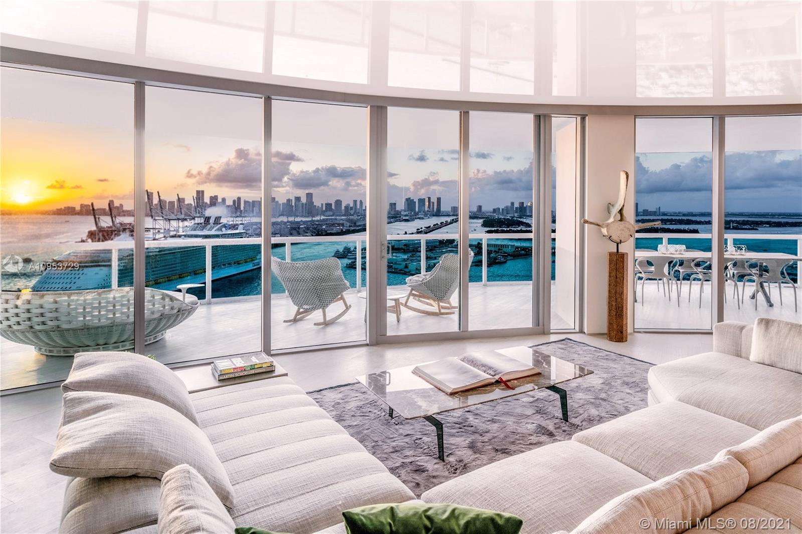 """Brand New, Sleek & Modern, and MOVE IN READY! NO EXPENSE SPARED to deliver this beautifully finished and furnished 3BR stunner to market. Known for its spectacular curved shape, wide open 3,365sf floor plan, and 300 degree views, the 01 line at Murano Portofino is without peers South of Fifth. Enjoy breathtaking expansive views of Ocean, Sunrise, Sunset, Beach, Skyline and Bay. Dine Al Fresco under the Miami stars on the 14 ft wide balcony. Entertain to your hearts desire in the large open Great Room with 2 living areas and an open Poliform Varenna kitchen. Polished attention to detail with ultra-luxe 16"""" Wide Oak floors throughout, Full Slab marble and Minotti furniture. For discerning buyers who are searching for a grownup apartment in South Beach, look no further. This is your new home!"""