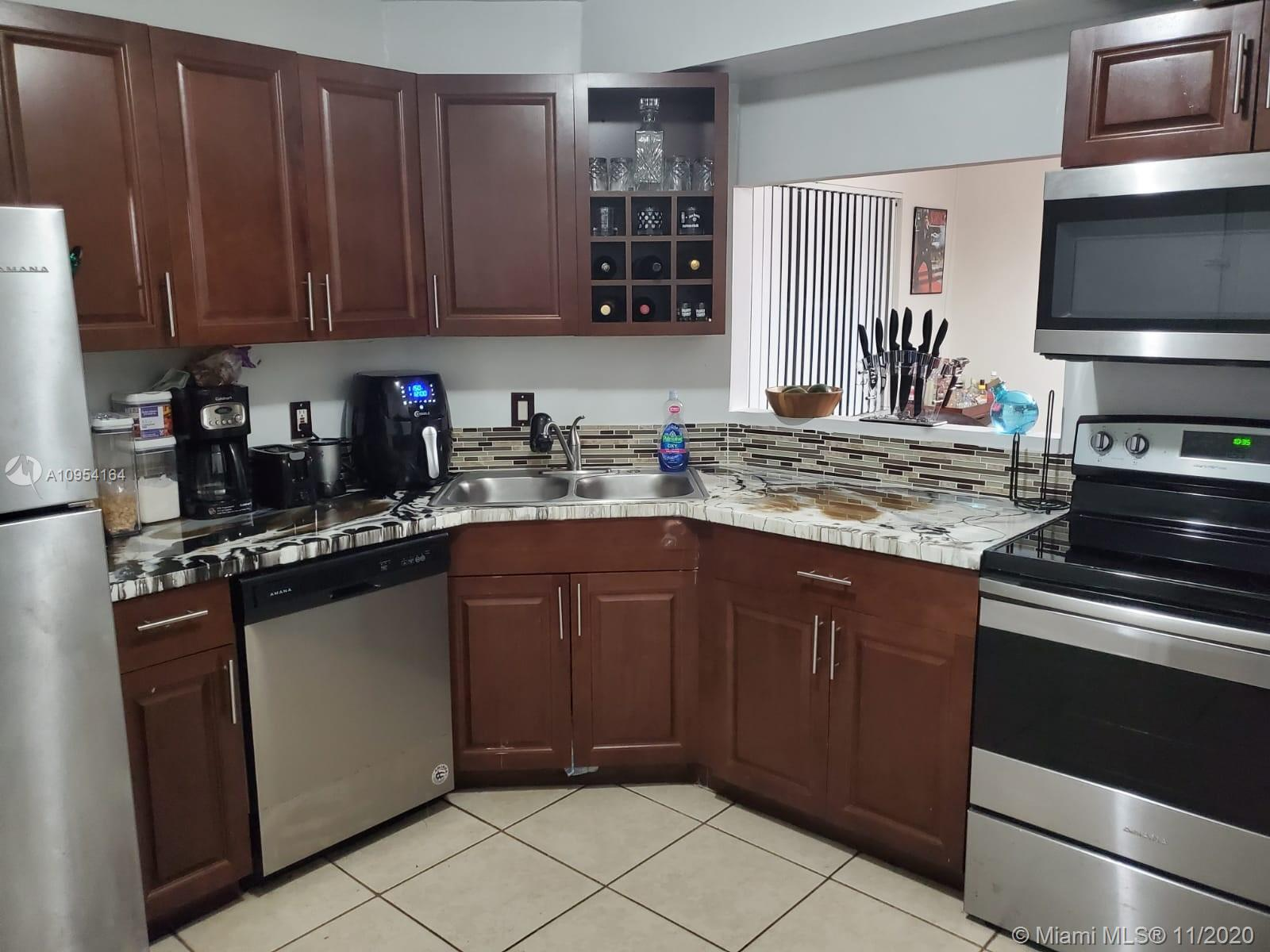 Renovated beautiful large 2/2 corner unit with amazing cross breeze, new wood flooring, stunning cherry wood kitchen cabinets, new stainless steel appliances, tiled backsplash and a lot of closet and cabinet space. ALL AGES WELCOME. Master bedroom has 3 closets, 2 walkins and a single with a long spacious bathroom. 2nd bathroom completely remodeled. Split floor plan with a large dining room/entertainment room and living room, very spacious with a eat in kitchen, perfect for entertaining.  Charming peaceful balcony view. A must see won't last long. Seller wants offers on this property. SHOWING SAT & SUN ONLY. Close proximity to Sawgrass Mills mall, 5 minutes to Publix, gas stations, major banks, starbucks & Walmart. Convenient access to turnpike.