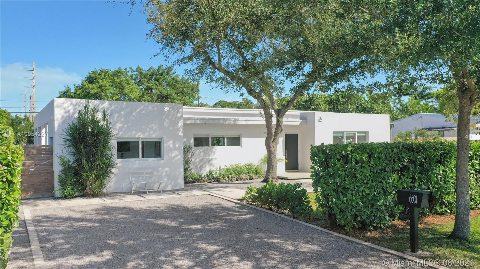 Tastefully renovated gem in the heart of South Miami. This 3-bed, 2-bath pool home has a very bright & functional layout with tile floors, LED lighting, impact windows/doors & modern kitchen with quartz countertops, cooking island with polished concrete top & a built-in refrigerator. Fire up the outdoor grill & entertain in the covered patio while overlooking the splendid salt-water pool. Master bedroom has an extra-large closet & provides access to a cozy outdoor lounge area, to unwind while gazing at the mature native plants edging around the near 11,000 sq ft fenced-in property. Perfect for families looking for a private, move-in ready home that offers vast space while allowing for future expansion, as its foundation is reinforced for a 2nd story. Schedule a visit or request the 3D tour