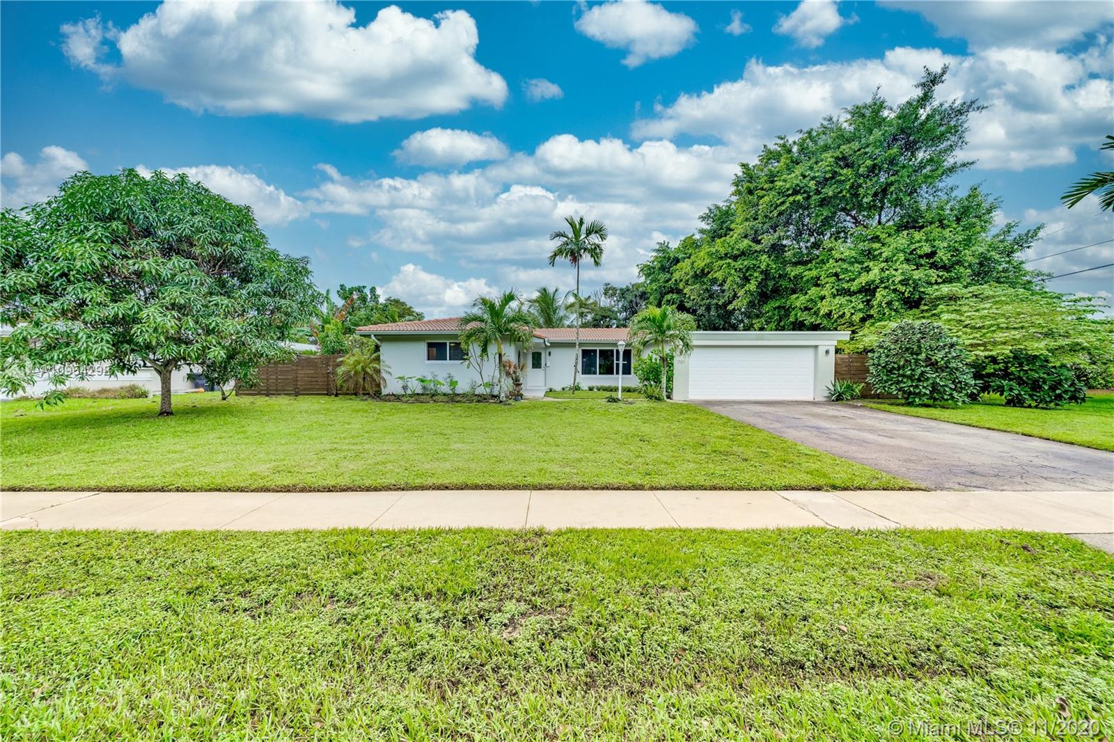 A Gardeners Delight in hot Plantation! Enjoy the foliage and mature fruit trees as you relax in your pool or sitting on your newly screened covered patio. Beautiful bright kitchen with granite counters, top of the line appliances and white shaker cabinets. Nice size laundry / pantry / utility room off the kitchen. Tile floors throughout. A/C replaced in 2015, flat roof just redone in 2020, barrel tile roof was installed in 2003, updates to the bathrooms and most importantly, hurricane impact doors and windows! This is a great place to call home!