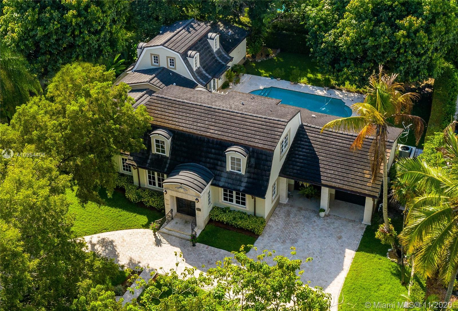 4000 + square foot French Chateau styled 2 story home at prized address on one of Coral Gables most iconic streets; Granada Boulevard. 4 bedrooms and 5 bathrooms. 1172 square foot main bedroom and bath addition in 2010. Original 1949 home was fully renovated in 2006. 100'X146' walled and gated lot with 17' X 34' pool. Impact glass doors and windows, marble floors, main bedroom and a guest bedroom on first floor. Two bedrooms, 2 baths upstairs. Roomy kitchen, remodeled in 2006 overlooks huge back yard and oversized swimming pool. Air conditioned two car garage. Elegant, charming and super spacious with a stunning 1000 + square foot main bedroom/bath suite. Some updating needed. Ideal location within walking distance to the Granada Golf Course and the Biltmore Hotel and Golf Course.