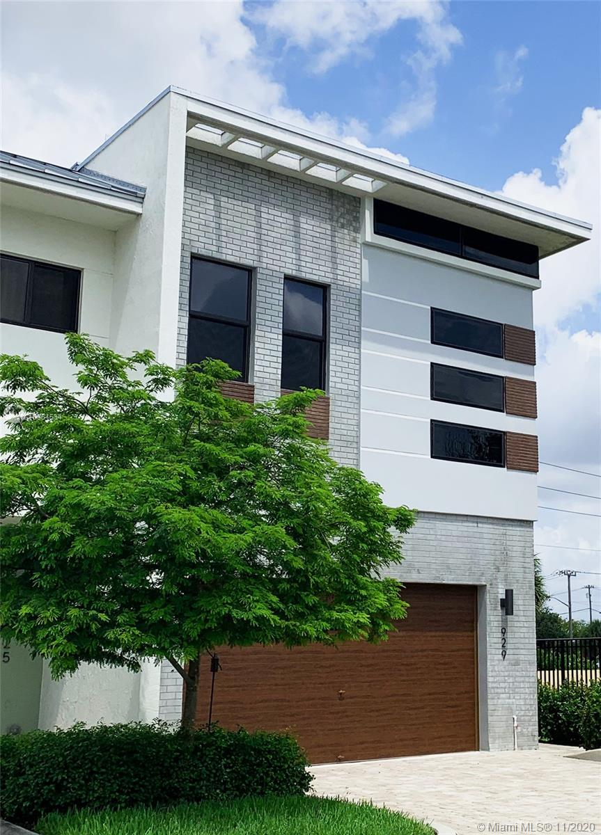 Beautiful, modern townhouse located in the gated community, Strata at Plantation. This Thorin model is a corner unit with a private side entrance. It has 3 bedrooms, loft area, patio that is accessible from the main living area, high ceilings, impact windows which are tinted for energy efficiency, Nest thermostat and security cameras. Contemporary, high-quality, state-of-the art designer accents, custom window treatments and unique light fixtures flow throughout the unit.  The kitchen has stainless steel appliances, European cabinetry and a signature island. First floor has ceramic floors. Wooden floors run through the staircase and the upper level. Master bedroom has 2 custom walk-in closets, a spa bathroom and a balcony. Clubhouse amenities include a pool, gym and a billiard room.