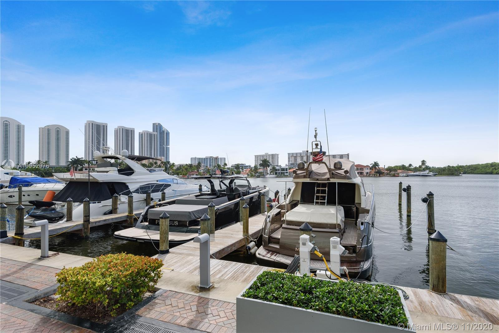 Boat lovers paradise! Enjoy beautiful views of both the marina and bay in this 2 story townhome with 2 bedrooms and 3 full bathrooms. This residence offers a spacious floor plan with marble floors in the living areas and wood styled flooring in the bedrooms. One bedroom and full bathroom are located downstairs and an open kitchen with designer appliances, including Bosch and Leibeher refrigerator. Washer & dryer are located within the unit on the second floor. Balcony overlooking the bay with direct ground floor access to marina. Building amenities include fitness center, spa, resort style heated pool, tennis courts, café & bar, 24 hour valet and lobby attendant. Marina Spaces available for rent. 1 Assigned parking space (#2052). Please add unit staged by Studio Kaza