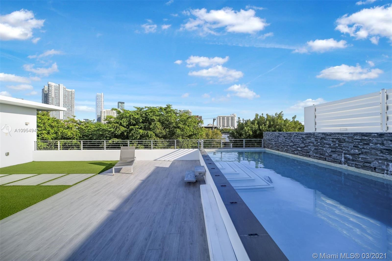 Brickell Broadways Villas just built in the Brickell Roads neighborhood. 4/4 plus garage and private roof top pool with stunning views of Brickell Downtown skyline. Ultra modern and open layout which includes large open terrace on second floor. 24 x 48 Porcelain tiles throughout. This new twin home structure is made of full concrete and a concrete slab roof. The windows and doors are hurricane impact from CGI. Modern gates add security, privacy and elegance. Grand entrance with beautiful chandelier and foyer. Perfect for executives and entertaining. Show and sell this exquisite masterpiece. Built by Sterling Developers, LLC.