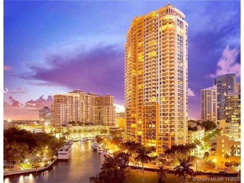 Waterfront condo with great river view located in the center of Las Olas. It's within walking distance of shopping, entertainment and nightlife. Quick access to Fort Lauderdale and Miami airport. Luxury amenities include fully equipped gym, resort-style pool, cabanas, dual barbecues, fully equipped clubhouse and gourmet coffee bar. This beautiful spacious unit features an expansive, dual entry floor plan and large riverfront terrace with access from the living room and master bedroom. The rear terrace features city and garden views. Additional attributes include a gourmet kitchen, floor-to-ceiling windows, sliding doors, motorized sunshades and Illuminates, contemporary fixtures and fans throughout the unit. The hallmark features of the unit are expansive custom closets.