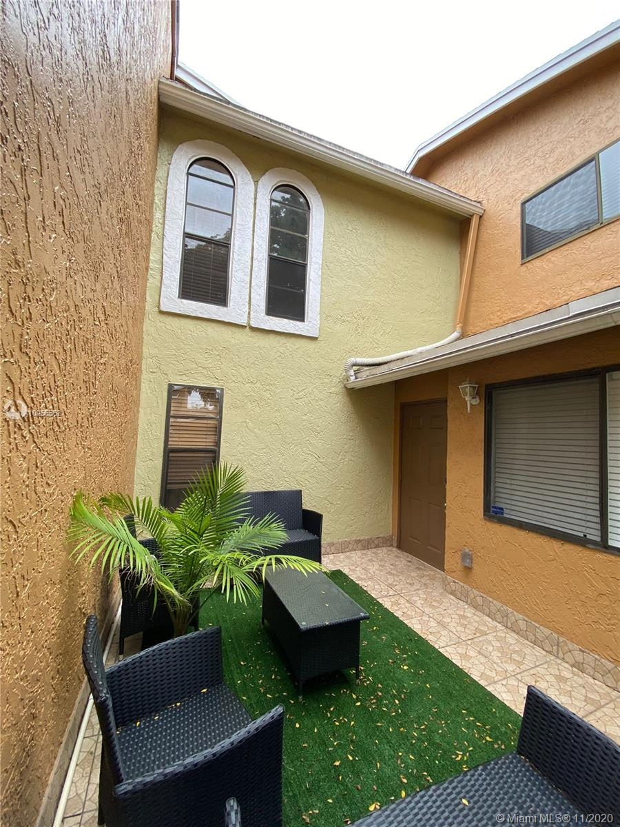 Check out this spacious 3/3 townhome with 2 private courtyards. Tile on 1st floor and composite wood floor on 2nd floor.  Upgraded Kitchen with large passthrough window.  Master bedroom is on 2nd floor. Full size washer/ drier in the unit with extra storage under stairs. Home automation hardware is included.