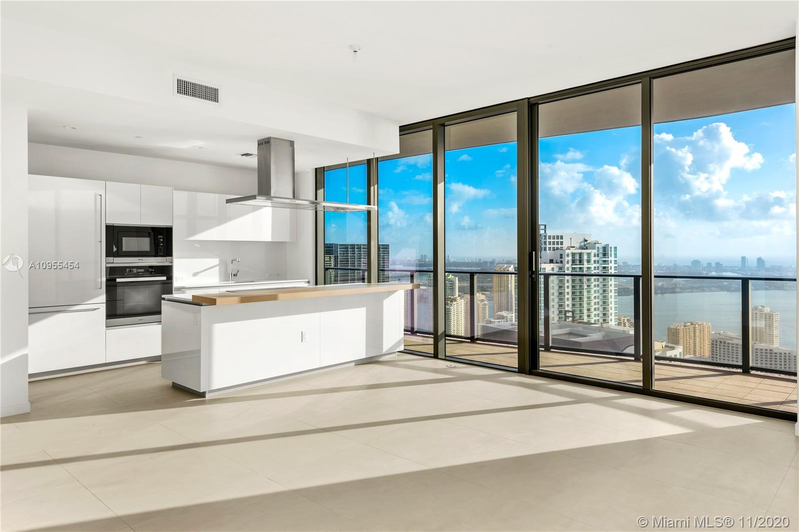 Worldclass views from this 3 Bed + Den/3.5 Bath Lower Penthouse at Brickell Flatiron with higher ceilings. Italian Porcelain floors, hidden hinge doors, Snaidero kitchens, and a great floorplan create an incredible home in the sky. Come see the rooftop pool, spa and fitness center with Pilates/yoga and aerobics studio, private steam and sauna facilities. Some of the other amenities include a children's play area, game room, movie theatre and recreation rooms. All in the heart of Brickell.