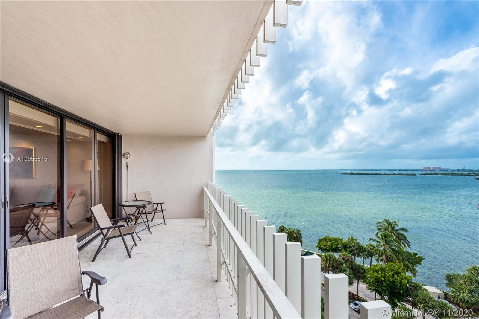 Incredible unobstructed views of South Biscayne Bay and Coconut Grove describes this beautiful 2 bedrooms 2 bath move-in-ready, entertainers delight with bay views from every room. The custom kitchen includes a bar counter open to the living area with granite countertops, GE profile appliances, and lots of cabinetry for storage. Other features include a built-in wet bar with wine cooler, new bathrooms, electric shades, custom lighting, new ac, marble floors, and spacious closets. Enjoy amazing sunsets on your terrace! Grove Isle is a secure guard gated 20-acre private island in the heart of Miami's Coconut Grove with a marina, pool, beach BBQ, and walking paths.