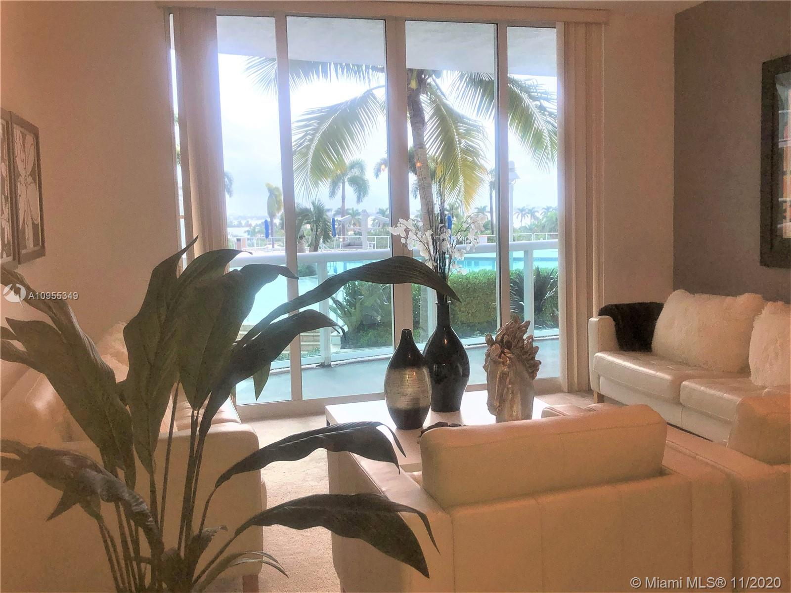 This spacious and bright condo residence features 2 Bed 2 Bath split floor plan. Marble floors in entrance, kitchen and bathrooms. Panoramic floor to ceiling impact windows. Open kitchen with snack bar.  Master Bath with dual vanity, spa tub and glass shower. Walk-ins closet. Sit and relax in the oversize balcony with gorgeous views of Biscayne Bay and the Intracoastal Waterway. It is a true water lover's paradise with a private slip, on-site marina. 360 Condo provides upscale amenities such as a bayside pool, fitness center, men and women's saunas, 24-hour guard gate service, valet, covered entrance, and garage parking. With an exceptional location, 20 minutes from the Miami International Airport, South Beach, downtown Miami and Brickell Ave, and 15 minutes from the Shops at Bal Harbour.