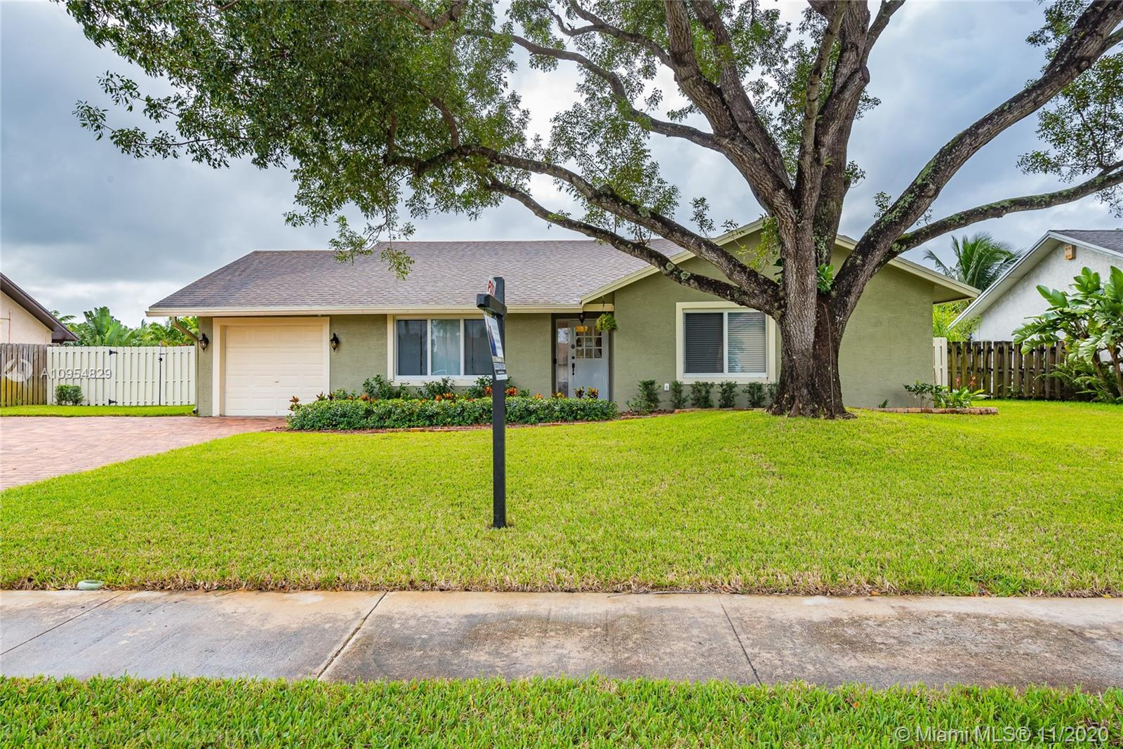 This stunning one-story home is located in the desirable neighborhood of Jacaranda Lakes, in Plantation.  This beautiful home offers from a private large living room area to a open concept kitchen and dining  area that faces the absolutely gorgeous swimming pool and coverage patio area.  Recent upgrades include a new roof from 2016, A/C replaced in 2018, water heater, refrigerator, impact windows and doors , pool fence , washer and dryer, smart electrical switch, approximately only one year old.  Absolutely  gorgeous !  don't miss it. Showing this Saturday 14th from 12:00 - 2:00 Pm