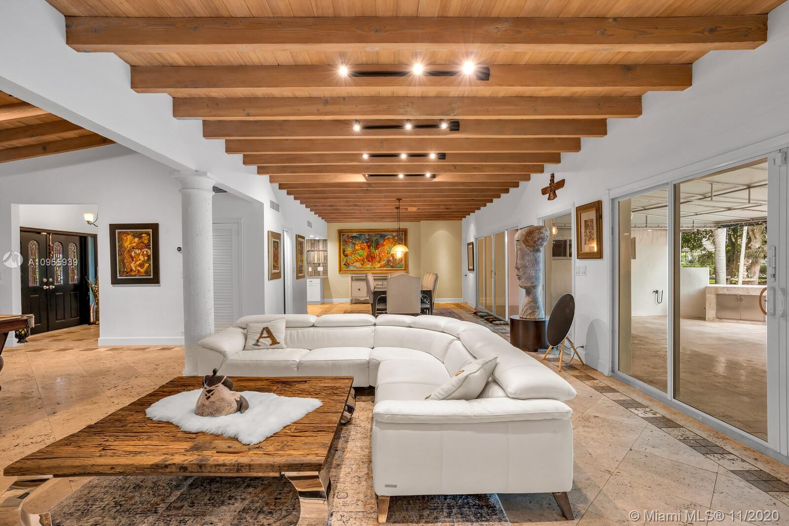 A true GEM, a UNIQUE Lot of 65,340 Sq.FT with 5,637 Sq.FT one story home in South Miami. Travertine floors throughout, beautiful White Oak wood ceiling, fire place, open floor through the living room, dining room and the kitchen. 4 Bedrooms, 4 Bathrooms, Guest House with separate entrance, spacious kitchen, Laundry room, very large patio surrounded by lush landscaping with multiple fruit trees such as 6 Mango and 2 avocado Trees. Fenced area dedicated to your Farm/Ranch. Zoning allows to have a HORSE, goats, sheep, chickens. Enough land to have your own garden and grow your own vegetables. Peaceful neighborhood close to Dadeland Mall, University of Miami, 20 min from Downtown Miami and to Miami International Airport, Top Rated schools. Furniture, FINE ART negotiable.