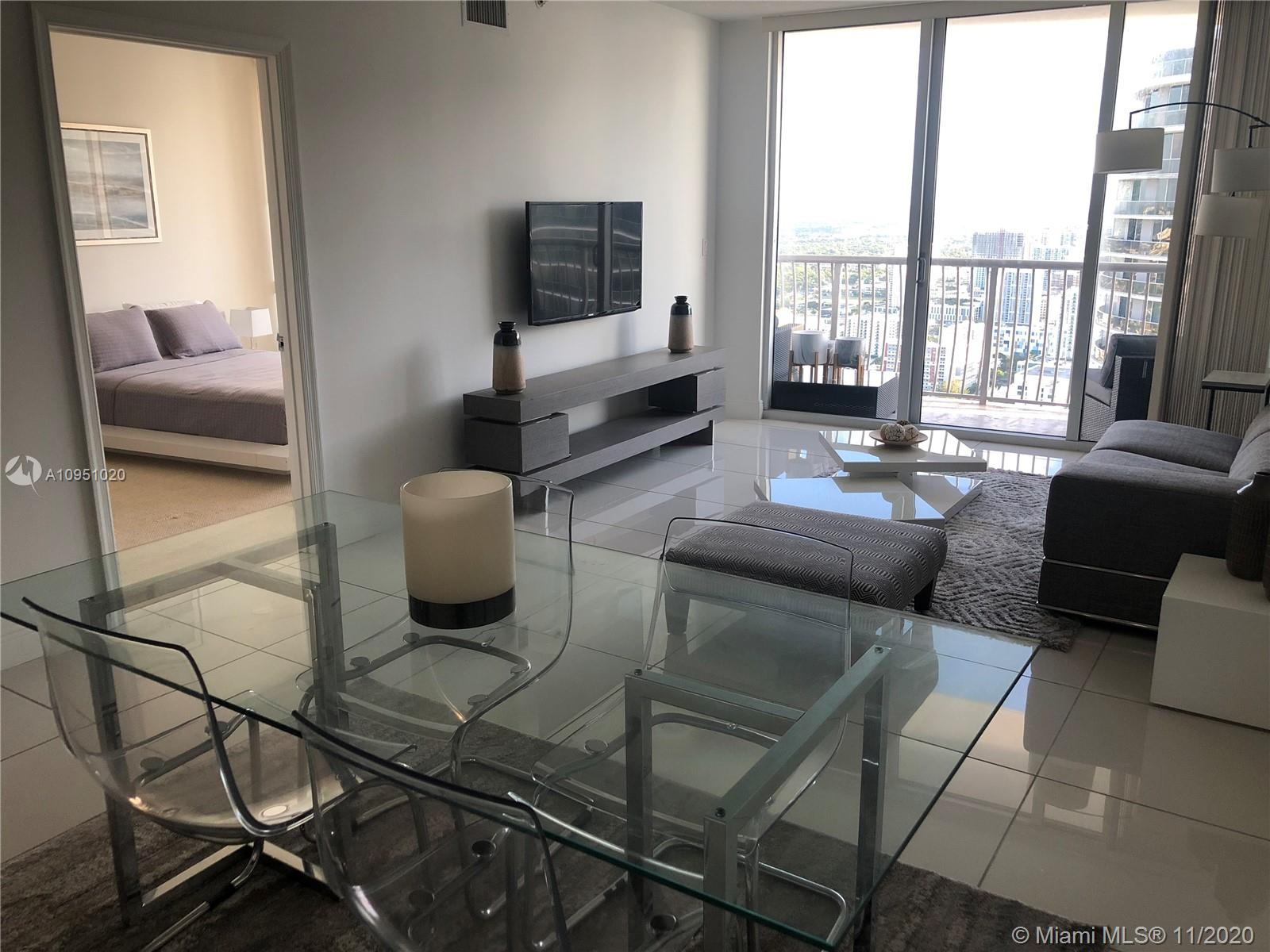 Enjoy breathtaking views of the city and Biscayne Bay in this elegant and comfortable one-bedroom Penthouse on the 54th floor. 1bed/1bath, w/c, full size kitchen, living-dining room, w/d, ss appliances, marble countertop kitchen and aluminum shower panel tower with rainfall shower-head.   10 min drive from Miami Beach and Downtown. 20 min drive from Miami International Airport. Resort-style amenities like a fully-equipped fitness center and clubroom, lounge area overlooking the city and the bay (pool being remodeled) and convenient lobby shops.  Restaurants can be found at the building's ground floor and around the building. There is a convenience store at the lobby and formal grocery store one block away .