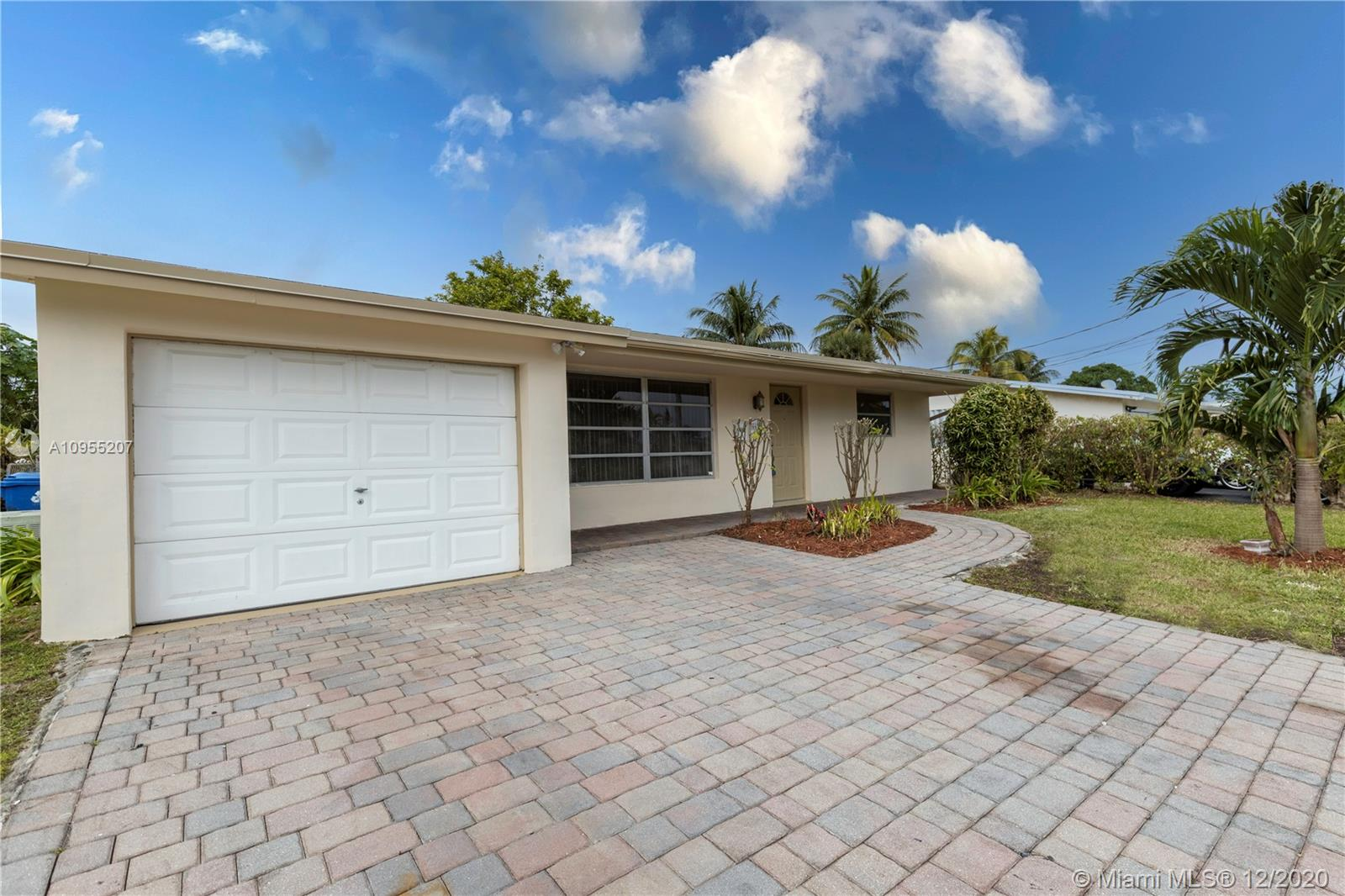 Enjoy the beautiful sunsets of South Florida and savor the sweet mangoes right from your own backyard. What else would you want more in your new home? The peaceful canal view adds to the updated new modern kitchen and 3 stacked bedrooms style home. The Florida Room enclosed can be the sunshine of the rainy days. The spacious driveway can be a convenience while family and friends are visiting. This home has NO HOA. It will not last long, come check it out!