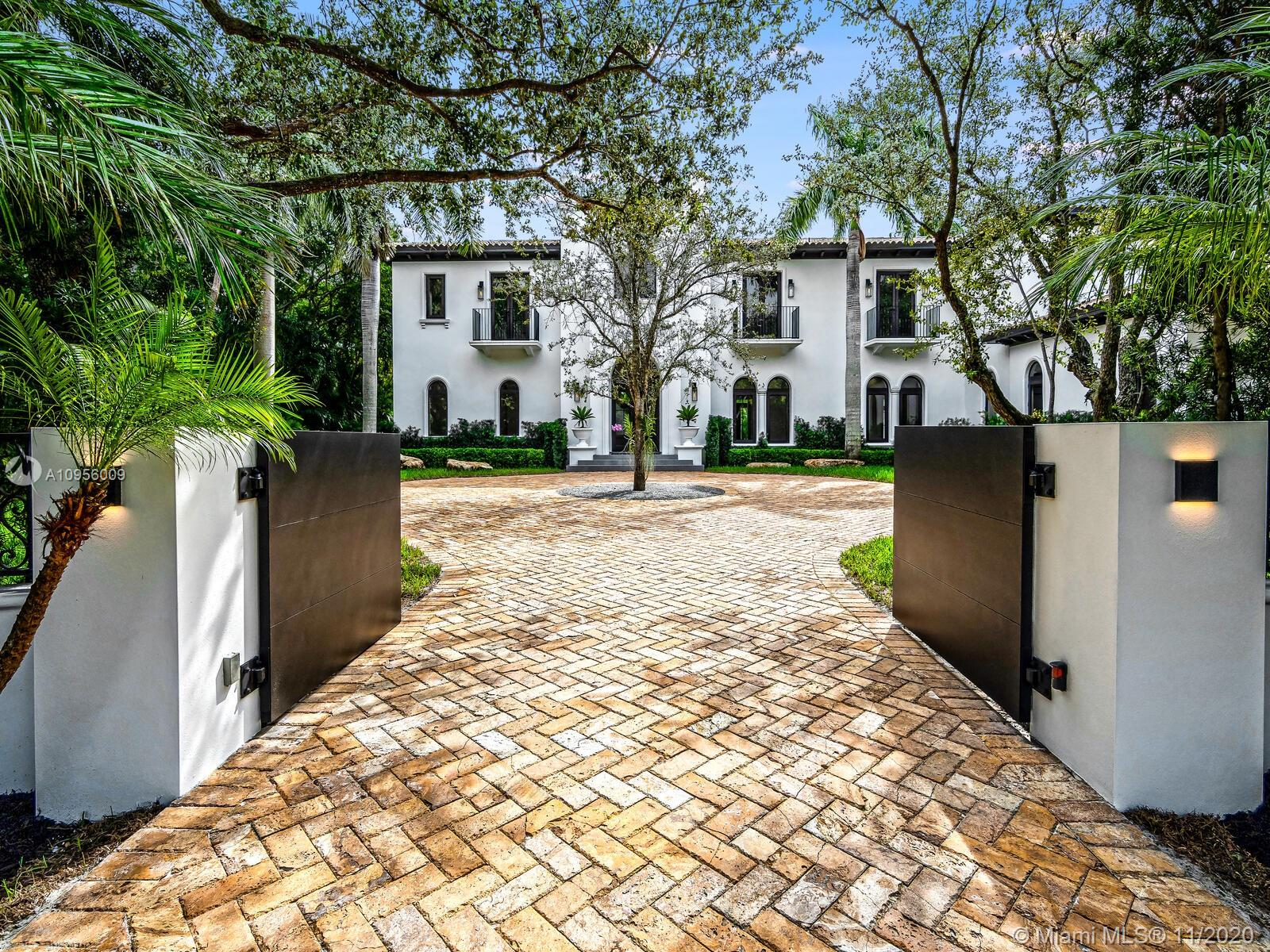 Recently renovated, this timeless estate is the epitome of Miami lifestyle. Enter through the dramatic foyer and fall in love with the curved staircase and rustic wood beamed ceiling. Modern & traditional details blend seamlessly to enhance the visual impact throughout. Architecturally-rich home has 9,848 total sq/ft with 7BD/7.5BA on a private builder's acre with majestic oaks. The kitchen is an epicurean dream with Wolf/Sub Zero appliances & floor to ceiling stained oak cabinets. Open family room w/built-in custom bar. Grand 1st floor master suite with stunning bathroom. Smart home w/Control 4 automated system. Built 15.2' above sea level with impact resistant windows/doors to insure you'll be prepared for any climate! Home is ideal for entertaining....offering style, comfort & luxury.