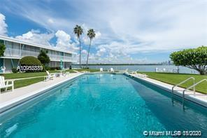 MAGNIFICENT, DIRECT,  UNCOMPROMISING OPEN WATER BAY VIEWS FROM THIS TRULY ONE OF A KIND, GROUND FLOOR, PRIVATE RESIDENCE. THIS MID-CENTURY GEM OF A BUILDING BOASTS AN ABUNDANCE OF GREEN LUSH LANDSCAPING, A HEATED BAY FRONT SWIMMING POOL, DOCK, KAYAK STORAGE, AND BBQ AREA. UNIT FEATURES FLOOR TO CEILING WINDOWS, TERRAZO FLOORING, CENTRAL A/C, DECO KITCHEN AND BATHS, AND YOUR OWN BAY FRONT BEACH. THIS IS THE HOME TO THE SHOWTIME SERIES DEXTER.