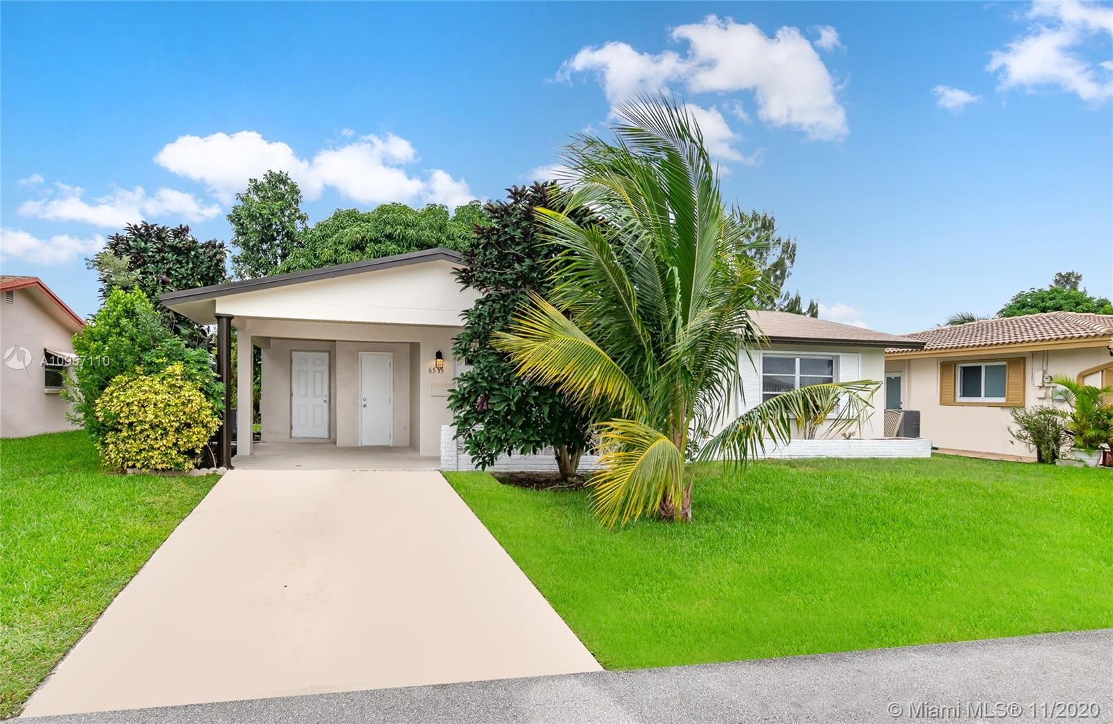 Amazing fully remodeled water-view home 2/2 in Mainlands of Tamarac Lakes for 55 years and older.  Spacious living/dining.  Eat-in wood kitchen with granite countertops, top of the line stainless steel appliances with pass thru Florida room.  Title throughout the house. Upgraded bathrooms. Walking closet.  Large terrace.  Attached carport with storage closet.  Tranquil canal view.  Association states HOPA.  Community pool and clubhouse.  Pet friendly.  No lease 2 years.  Walking distance to shops, banks, fine dining, bus routes and throughfares, and more.  Three minutes driving from Florida Turnpike and ten minutes driving from Sawgrass Express Way. Ease to show!!
