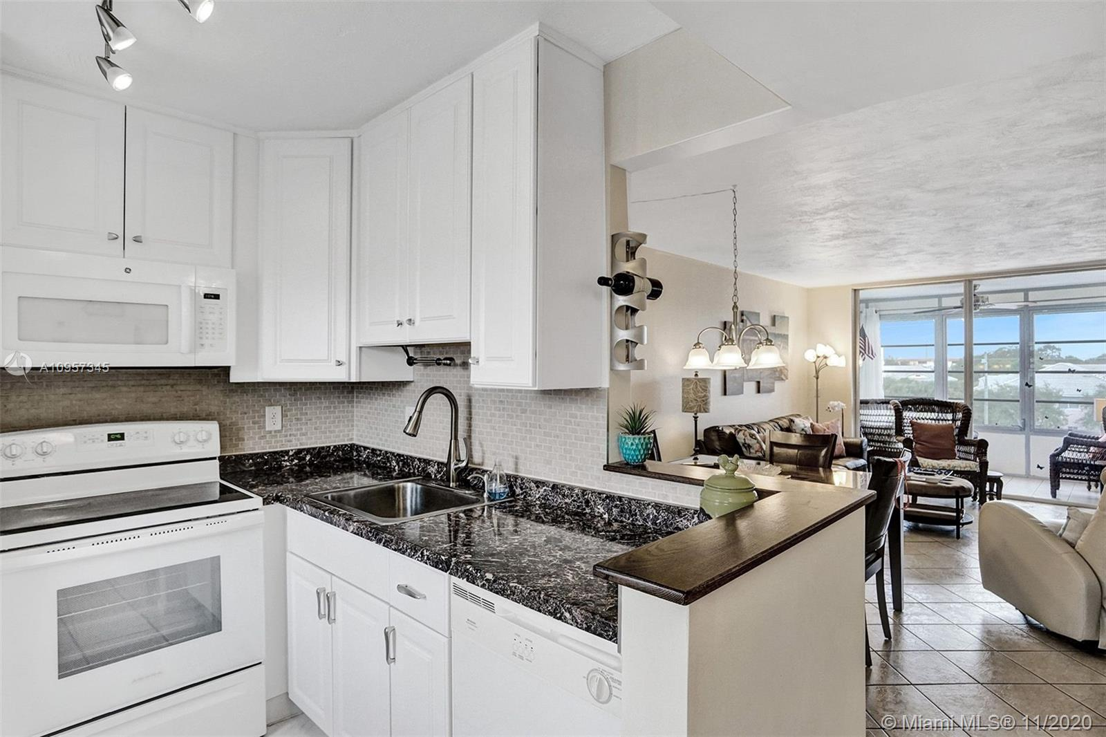 Beautiful corner unit completely remodeled with 1 bedroom and 1 bathroom in Somerset Phase 1.. Rare open kitchen with white cabinets all the way to the ceiling and new refrigerator. Tile floor throughout the entire unit, New AC and new thermostat. Large bedroom with walk-in closet. Wait until you see the bathroom, immaculate! Seller will sell furnished and turnkey (some exclusion) and ready to move in.  Community with lots of activities, heated pool, tennis, shuffleboard, bingo and more. Gated with security 24H and low maitenance fees. Closed to the restaurants, shops and casino, MUST SEE