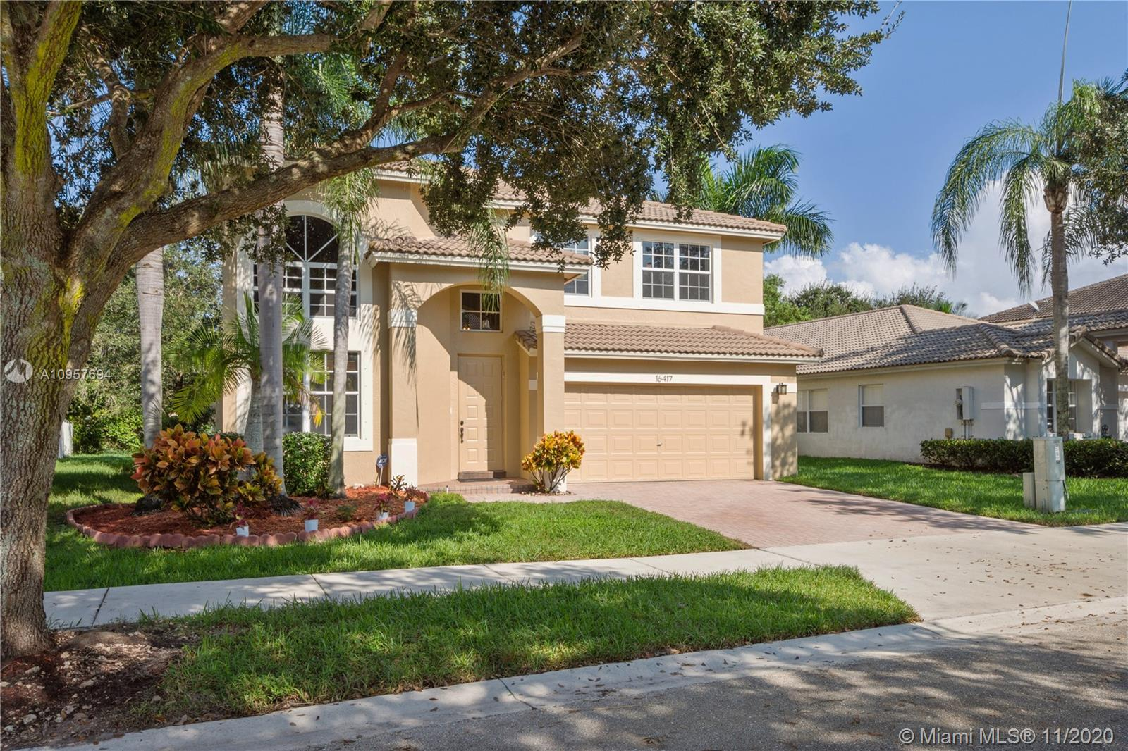 Just listed in the prestigious community of Emerald Estates. Built by Lennar with great parks and amenities and A+ school district. Peaceful 24hr guard-gated in the amazing City of Weston. This is the Jade Model with an open floor plan featuring 2812 Sqft A/C with 4 bd, 3 bth & large loft, 2 car garages. The 1st-floor bedroom is perfect for guests/office and loft is versatile. New impact windows on 2nd floor and hurricane panels for 1st floor. Recently renovated master bathroom, painted inside & outside, including garage floor, renovated white kitchen, newer appliances, & granite countertops.Laminate flooring on stairs and second floor. Newer water heater. Private lot and stunning garden views. HOA includes lawn maintenance, fertilizing, tree trimming, weeding, sprinklers, cable& much more
