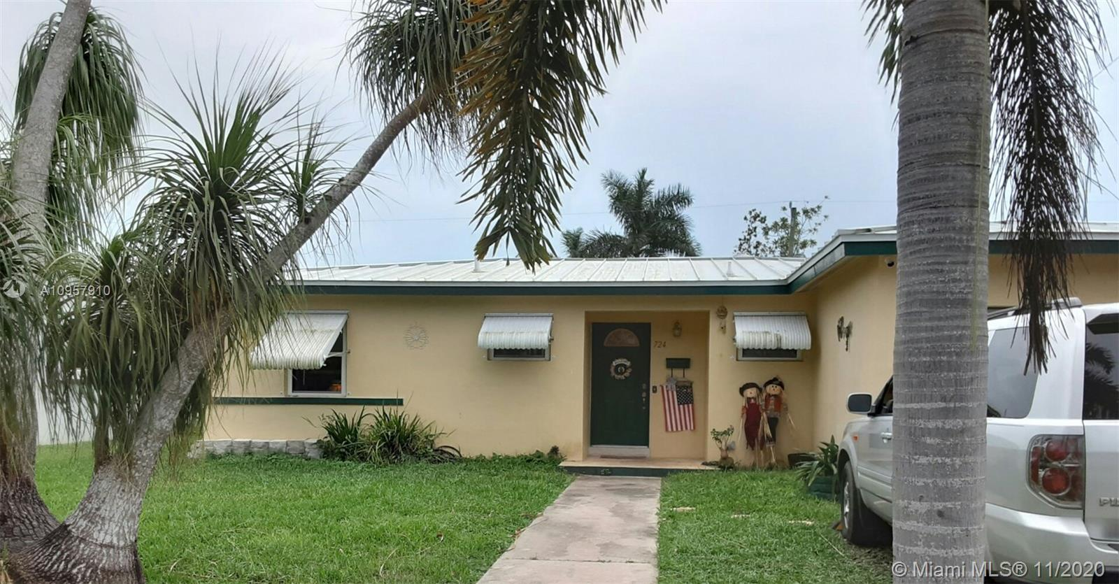 Reduced 3 Bedroom 2 bath 1354 sq ft incl. a 1/1 in law has side ddoo. New kitchen with stainless steel appliances. Terrazzo floors. Metal roof installed 2018. Chain link fenced large backyard with tall Cherry hegde, & fruit bearing mature trees: Hog Plum (Ciruela), Lime, and Sour Sop (Guanavana) shed.  Excellent neighborhood with 2 parks within walking distance. Close to Campbell Drive, Krome, Wells Fargo bank, 