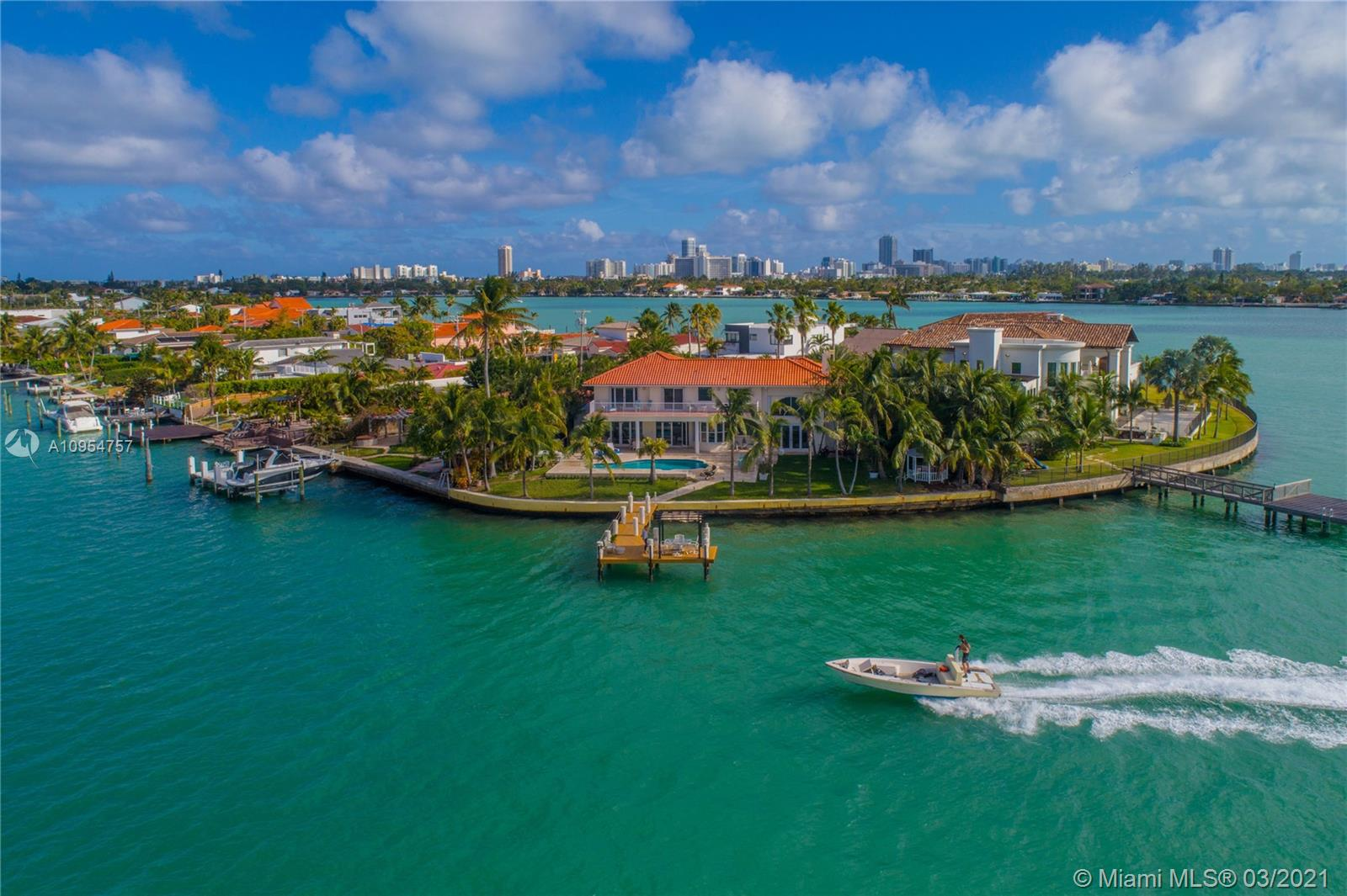 Exquisite home on peak of a gated street on a peninsula in Miami Beach. This 5/3.5 home offers safety, privacy and breathtaking wide bay views of Biscayne Bay and world renown Indian Creek's 50 million dollar homes. Deep water access with no bridges to bay and a dock with room for a large boat and 138 feet of waterfront. Italian Snaidero Kitchen with Miele appliances and an eat in kitchen with beautiful bay views. Marble floors are throughout. Formal living and dining rooms for entertaining. Master bath has jacuzzi tub, shower w/ bay views, and separate room for toilet and bidet. Beautiful sunrises and sunsets can bee seen from the dock,as can dolphins and manatees playing. 1.5 mile walk to the beach; Close to Bal Harbour shops, places of worship, beach. Sold subject to 1 yr rental $26k/mo